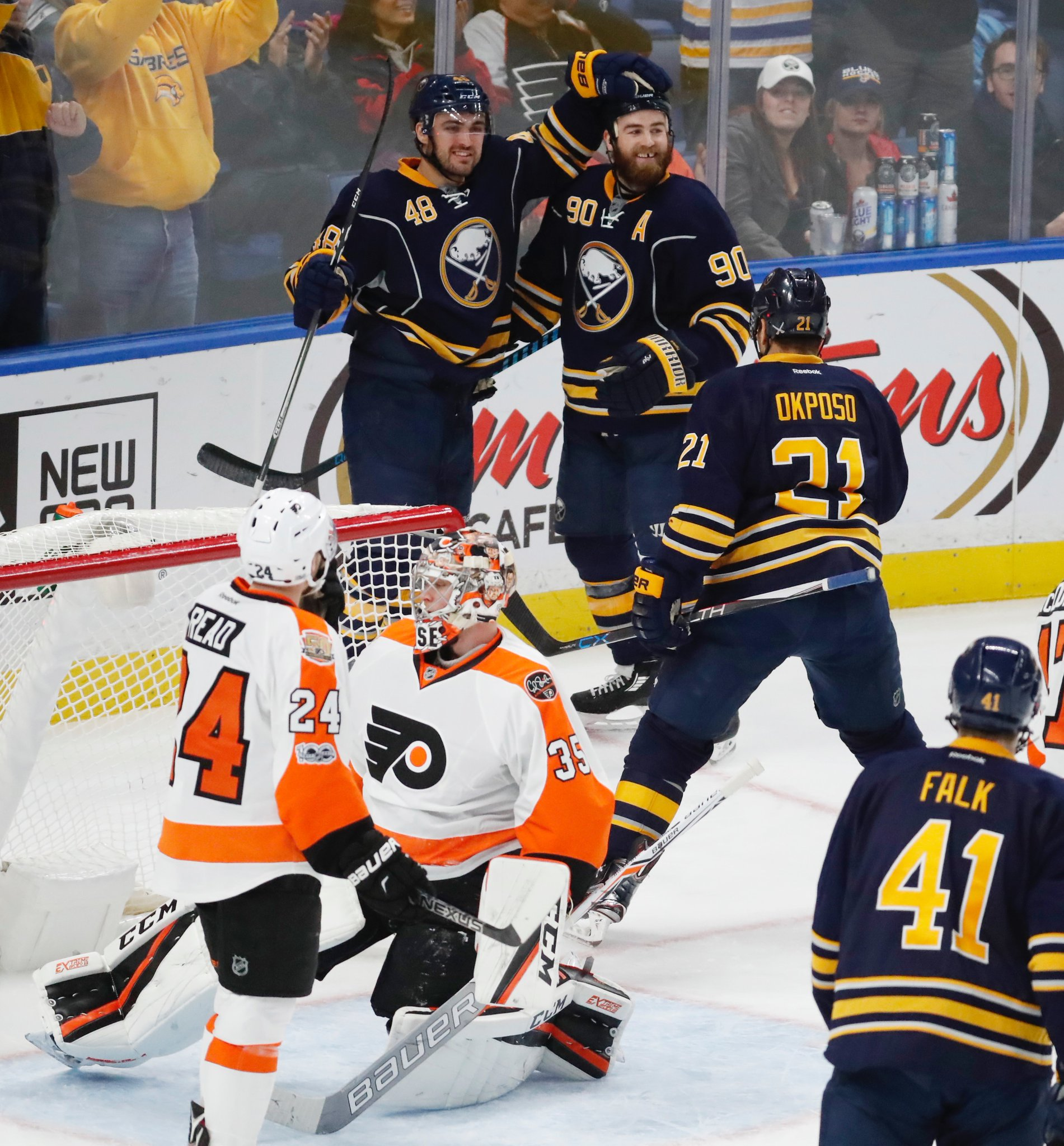 William Carrier (48) celebrates his goal Tuesday with Ryan O'Reilly and Kyle Okposo. (Harry Scull Jr./Buffalo News)