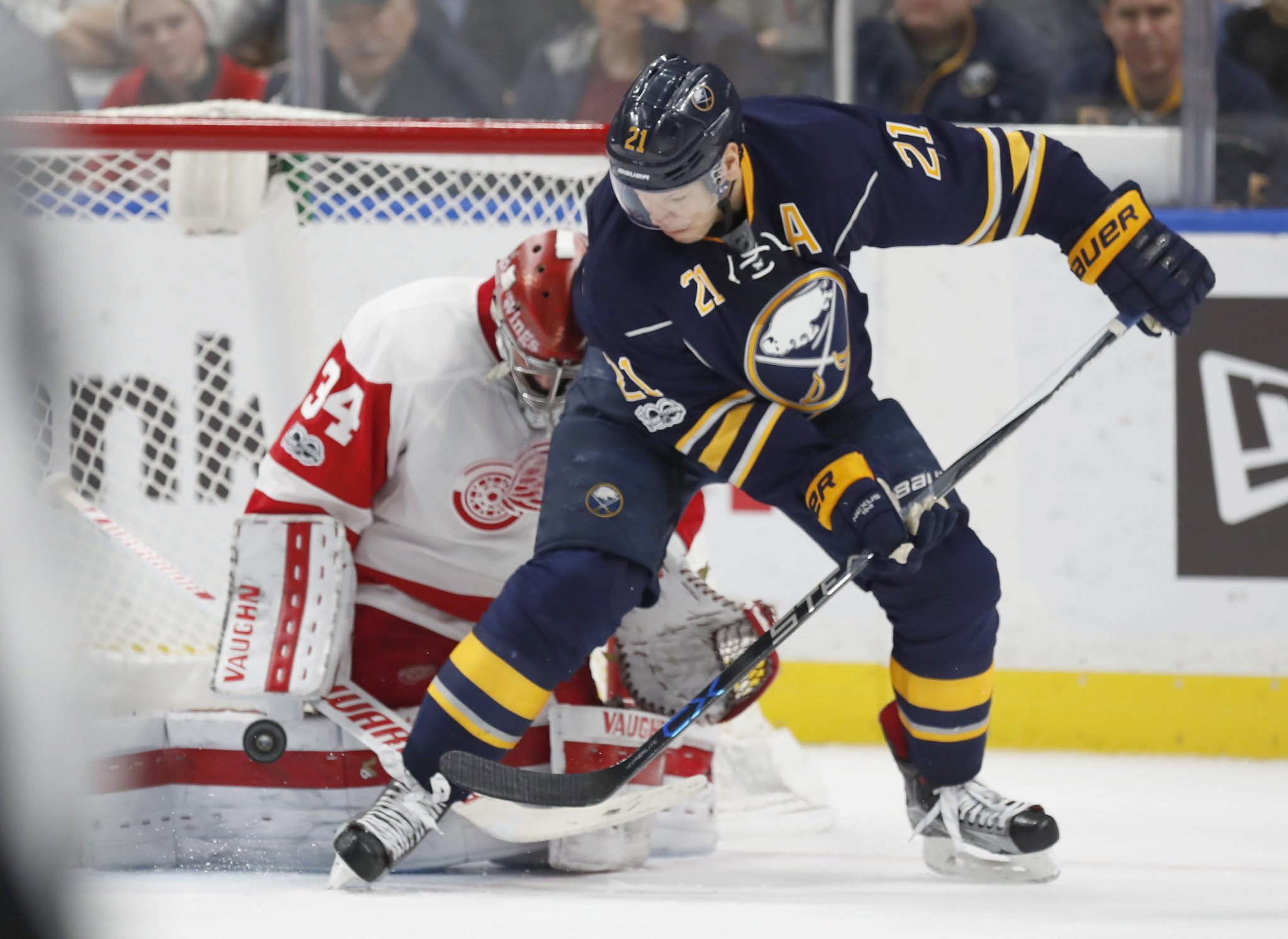 After getting pass from Ryan O'Reilly, Kyle Okposo scores the winner against Petr Mrazek. (Harry Scull Jr./Buffalo News)