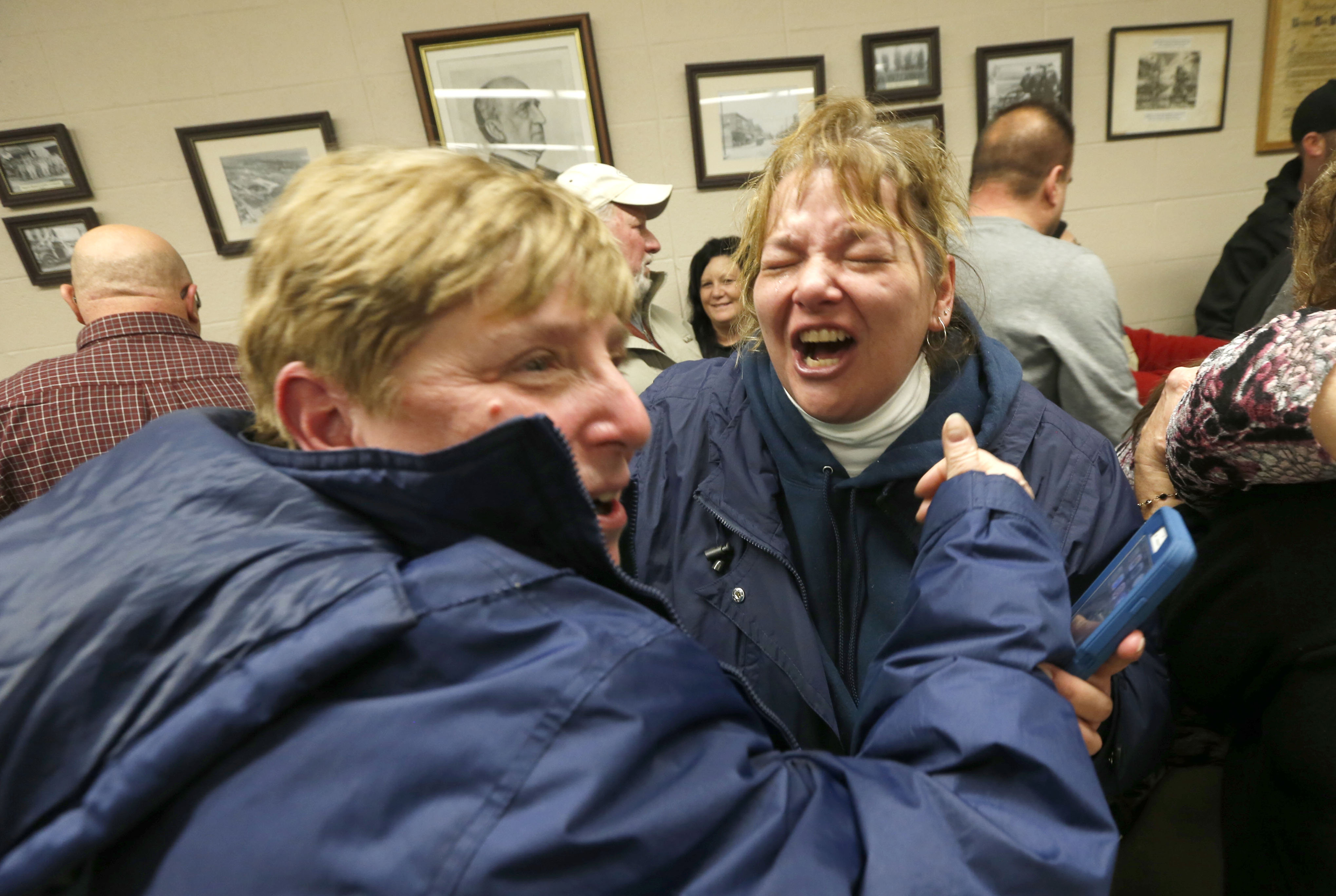 Village of Depew employee Shelley Matthews, right, and Judy Guarino, a 30-year village resident, celebrate Tuesday, Jan. 17, 2017 at Village Hall after voters rejected a referendum to eliminate the village and merge with two towns.   (Robert Kirkham/Buffalo News)