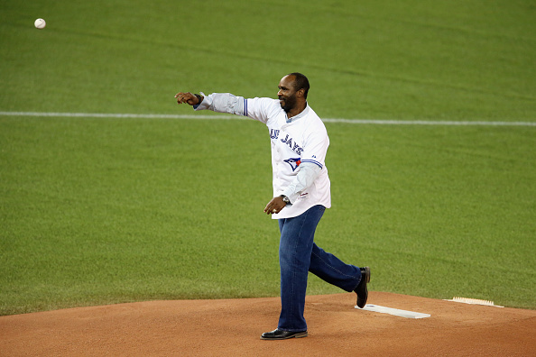 Devon White throws the ceremonial first pitch prior to Game Three of the 2015 ALCS between the Blue Jays and Royals in Rogers Centre (Getty Images).