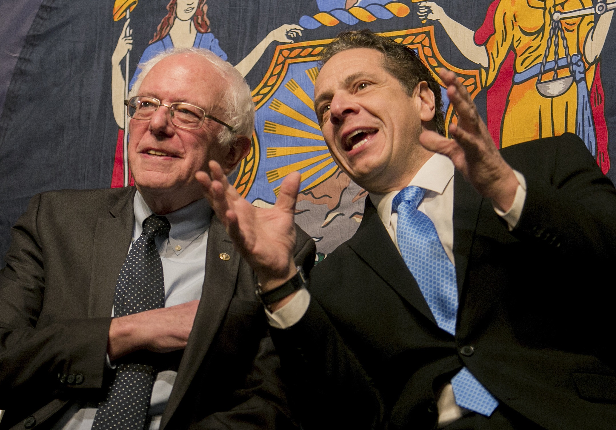 Gov. Andrew Cuomo, right, unveiled his plan for free SUNY tuition at an event with Vermont Sen. Bernie Sanders. (New York Times photo)