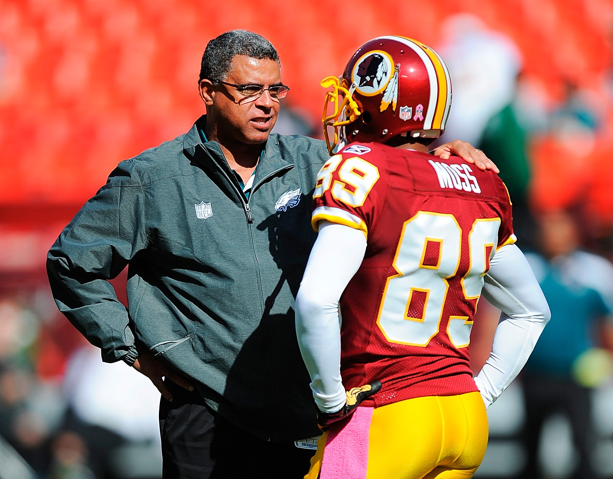 David Culley, during his time as Philadelphia Eagles wide receivers coach, talks with Santana Moss of Washington before a game at FedExField on Oct. 16, 2011. (Getty Images)