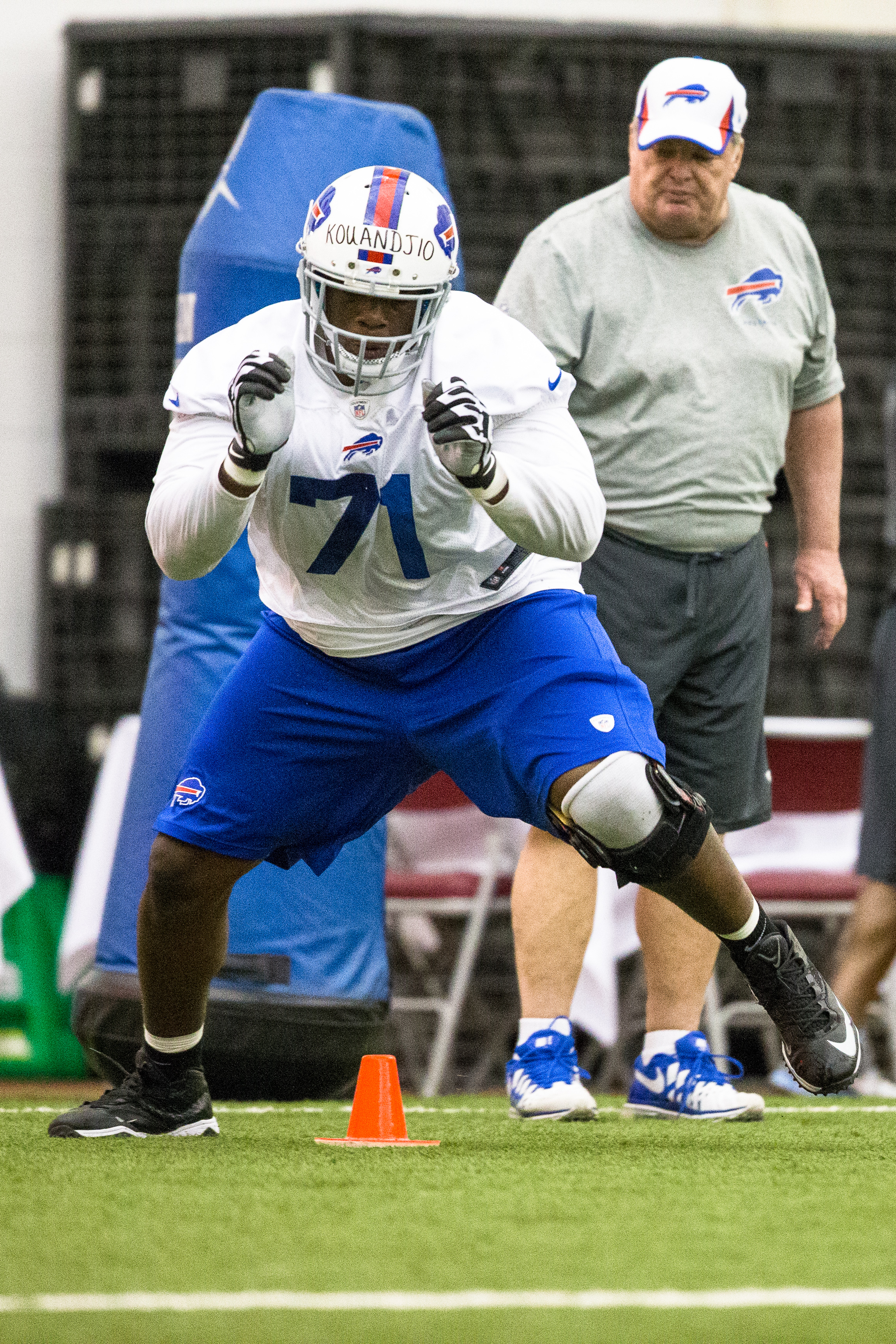 ORCHARD PARK, NY – May 18:  Cyrus Kouandjio #71 of Buffalo Bills takes part in drills during the Buffalo Bills rookie minicamp on May 18, 2014 at Ralph Wilson Stadium in Orchard Park, New York.  (Photo by Brett Carlsen/Getty Images)