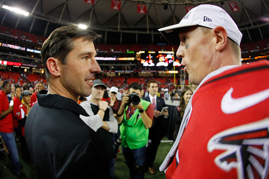 Atlanta Falcons offensive coordinator Kyle Shanahan celebrates with Matt Ryan after defeating the Green Bay Packers in the NFC Championship Game at the Georgia Dome on January 22, 2017 in Atlanta, Georgia. The Falcons defeated the Packers 44-21. (Getty Images)