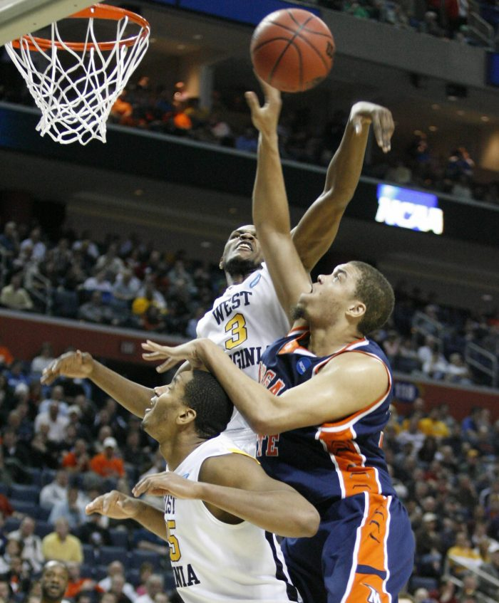 West Virginia forward Devin Ebanks (3) blocks the shot of Morgan State forward Kevin Thompson (33). (James P. McCoy/Buffalo News)
