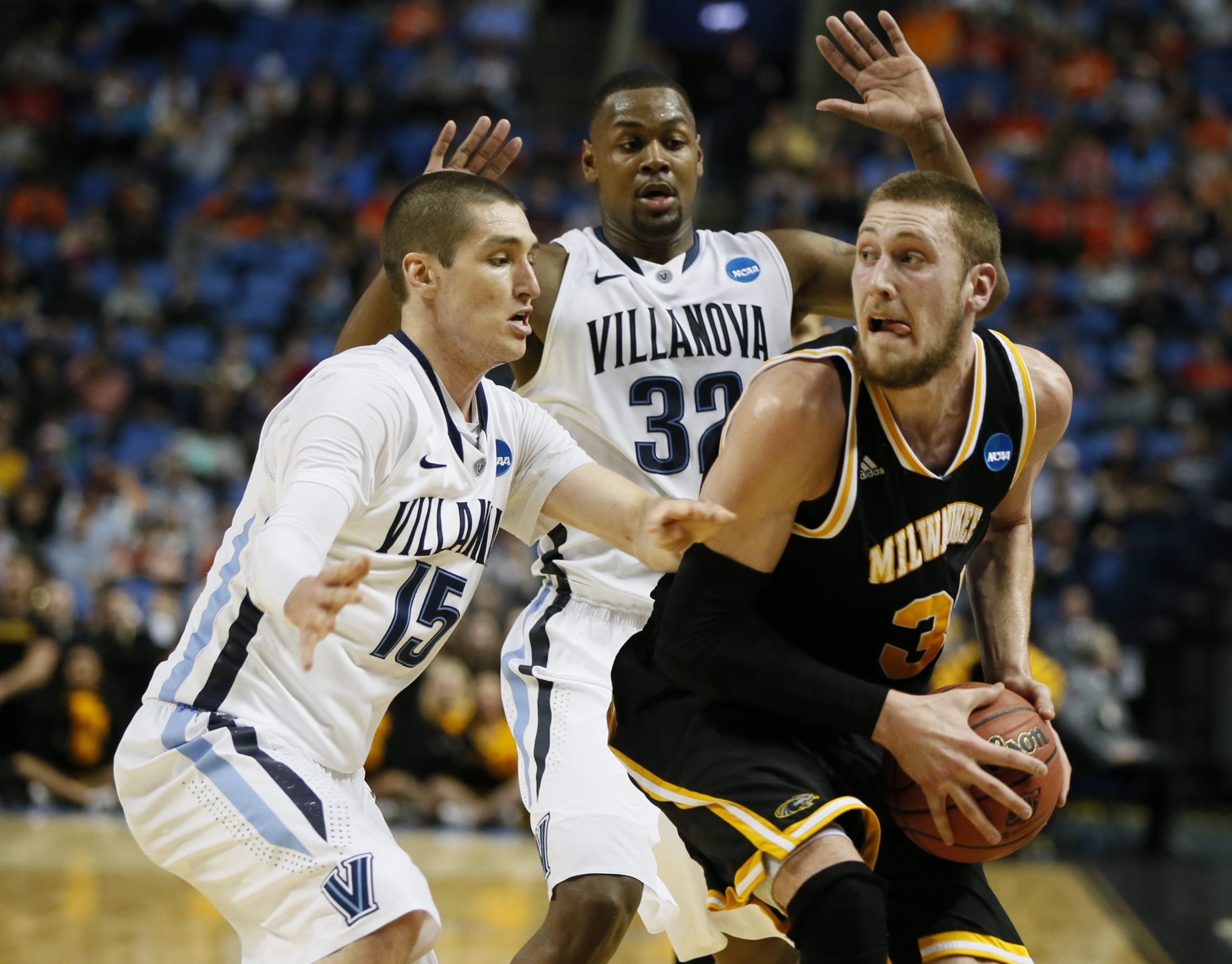 Milwaukee's Matt Tiby (32) looks for options while being double-teamed by Villanova's Ryan Arcidiacono, left, and James Bell.  (Harry Scull Jr./Buffalo News)