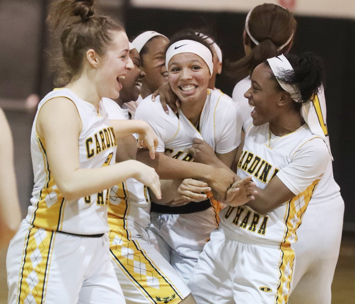 Cardinal O'Hara is mighty happy about its girls basketball season; it's been No. 1 all year. (James P. McCoy/Buffalo News)