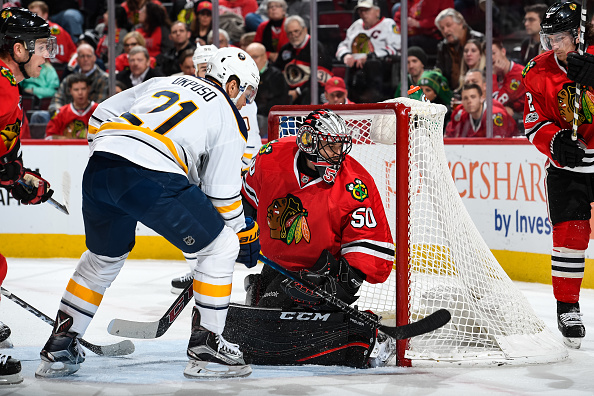 Kyle Okposo jams the puck past Corey Crawford to give the Sabres a 2-1 lead late in the second period (Getty Images).