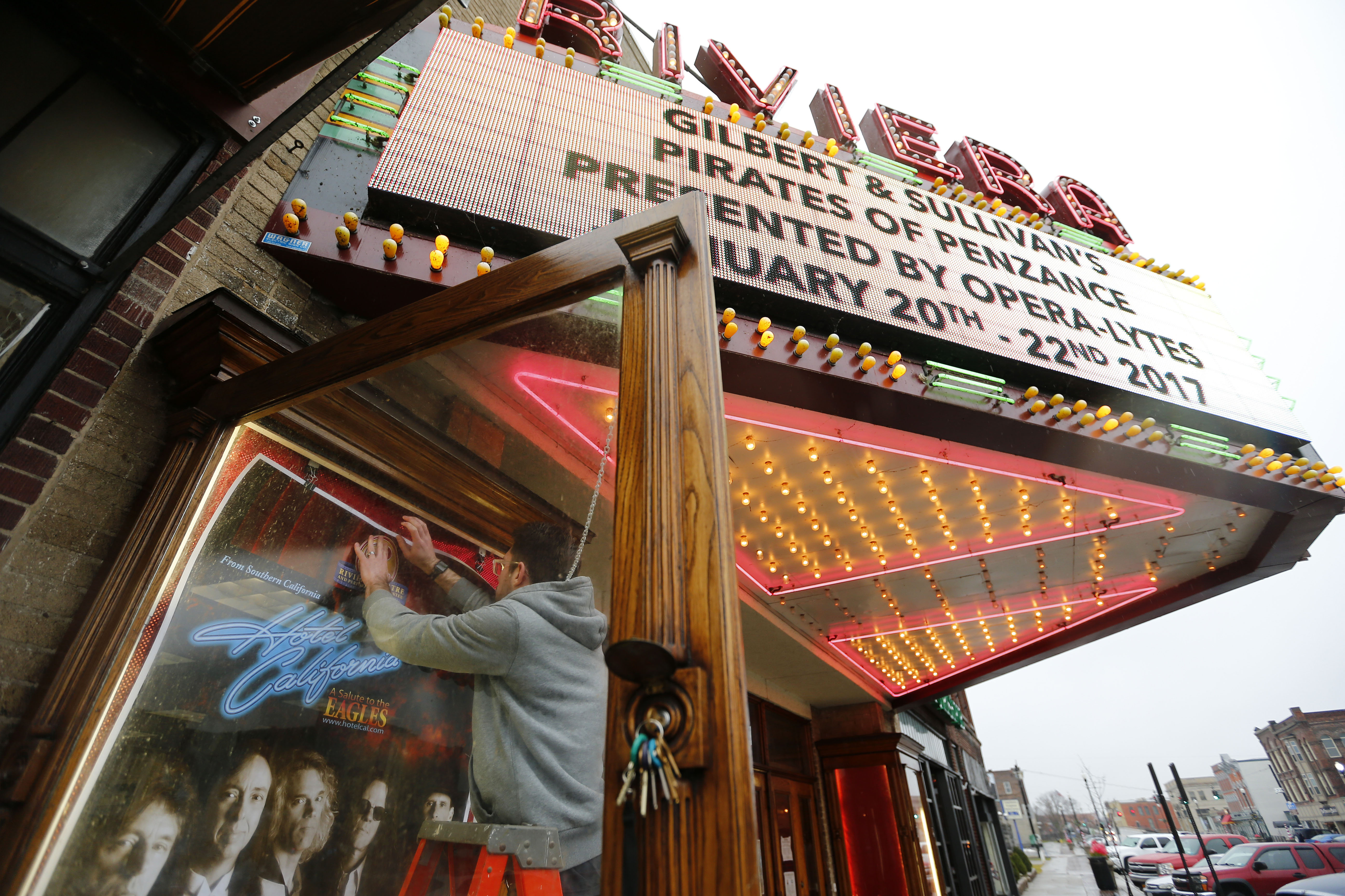 Derek Heckler pins up a sign in the case next to the marquee at the Riviera Theatre &  Performing Arts Center in North Tonawanda  on Tuesday, January 3, 2017.      (Mark Mulville/The Buffalo News)