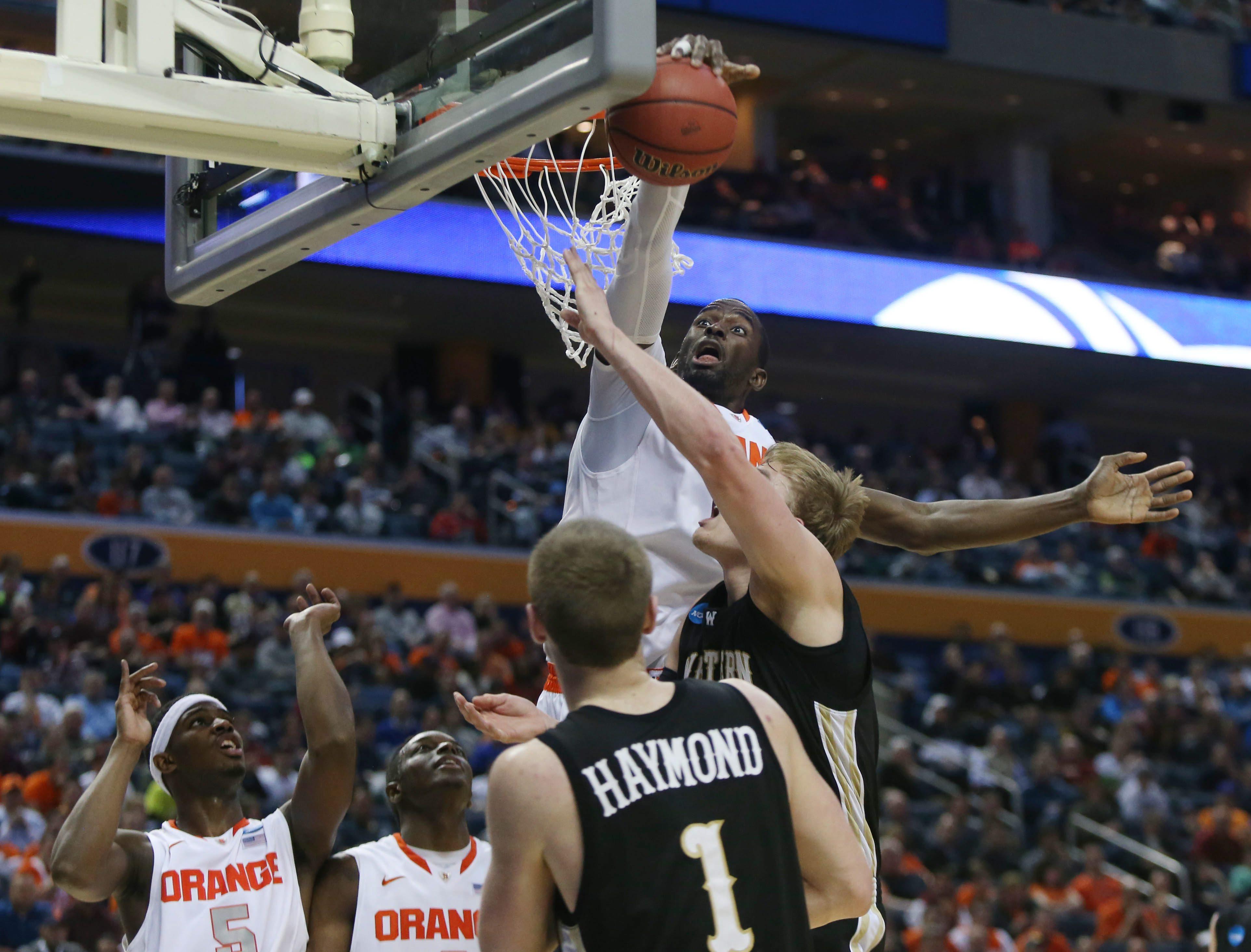 Syracuse's Baye-Moussa Keita blocks a shot attempt by Western Michigan's Connor Tava.  (Robert Kirkham/Buffalo News)