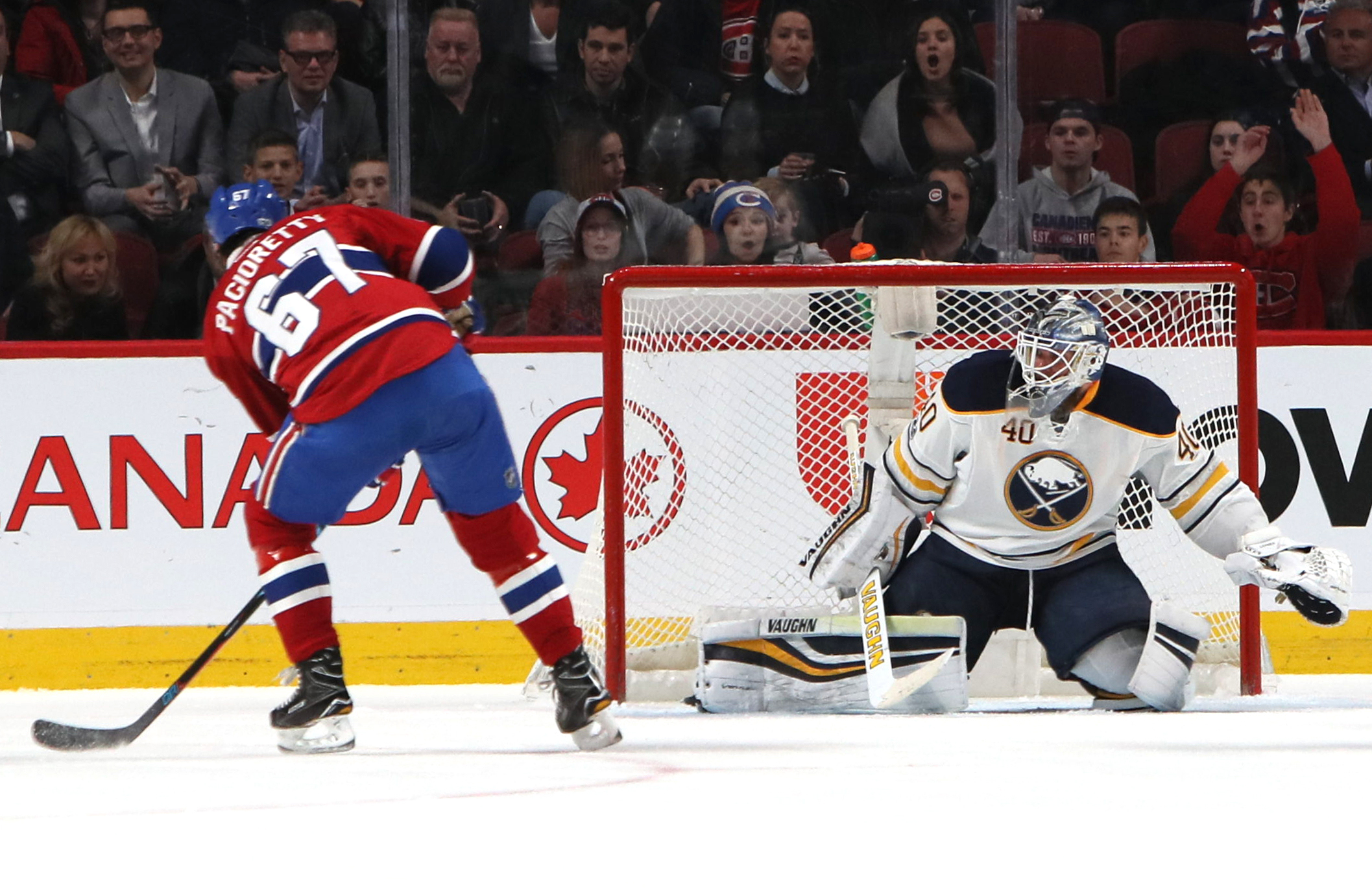 Montreal's Max Pacioretty scores one of his three goals against Buffalo goaltender Robin Lehner Tuesday at the Bell Centre. (Jean-Yves Ahern/USA TODAY)