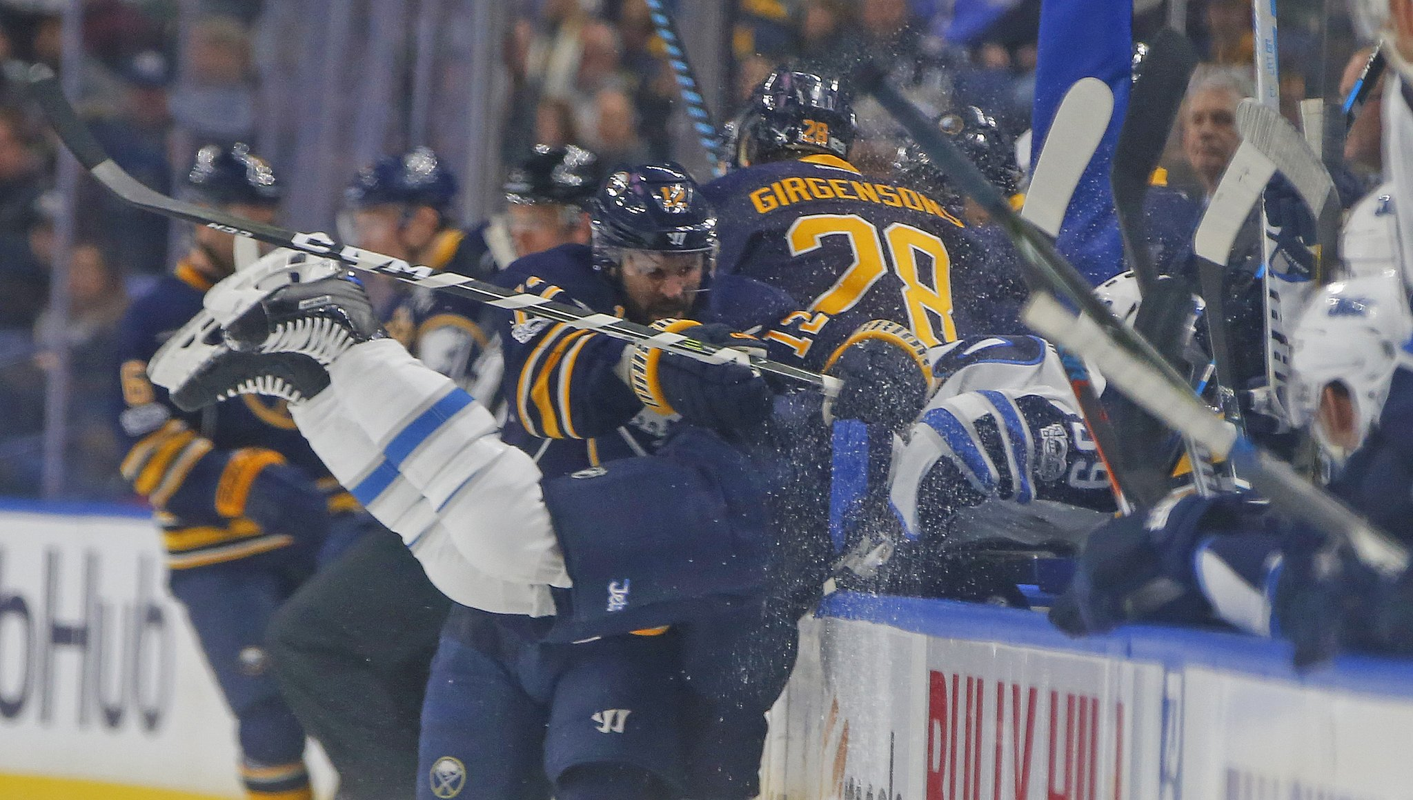 Brian Gionta and the Sabres got physical with Toby Enstrom and the Jets. (Harry Scull Jr./Buffalo News)