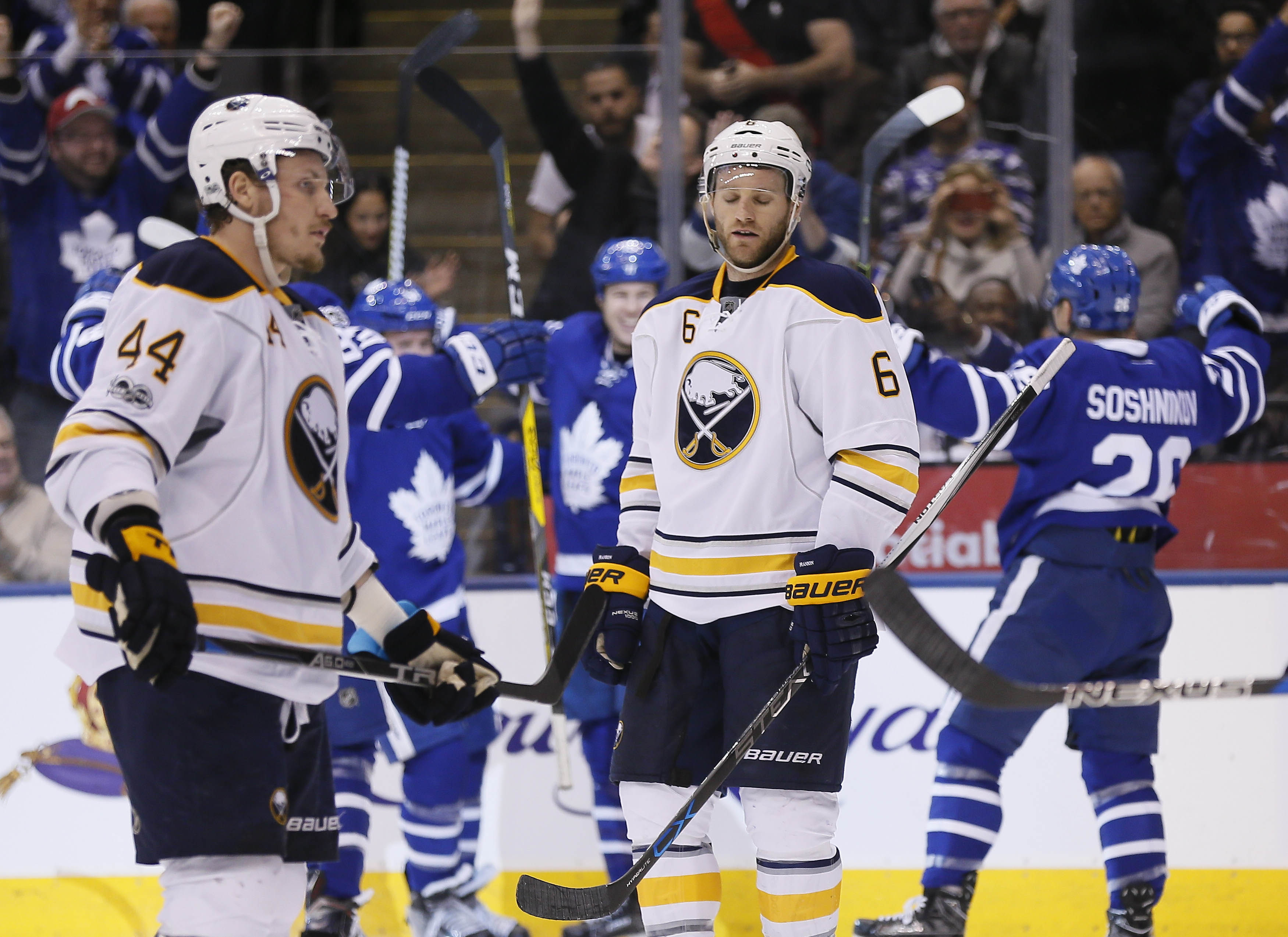 Nic Deslauriers and Cody Franson (6) react after Matt Martin's goal in the second period got the Leafs even.  (John E. Sokolowski-USA TODAY Sports).