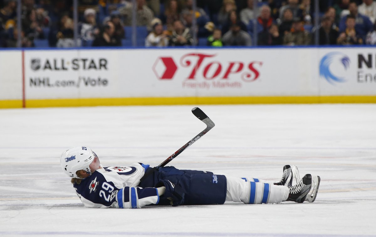 Patrik Laine took the full force of a head-on hit from Jake McCabe in the third period. (Harry Scull Jr./Buffalo News)