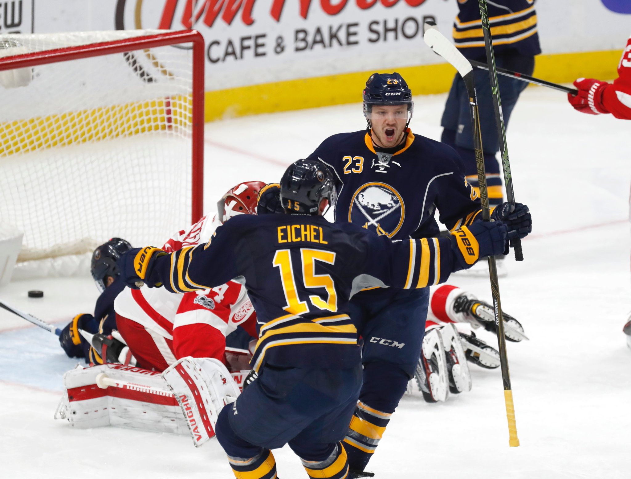 Sam Reinhart (23) and Jack Eichel celebrate Reinhart's 10th goal of the season Friday. (Harry Scull Jr./Buffalo News)