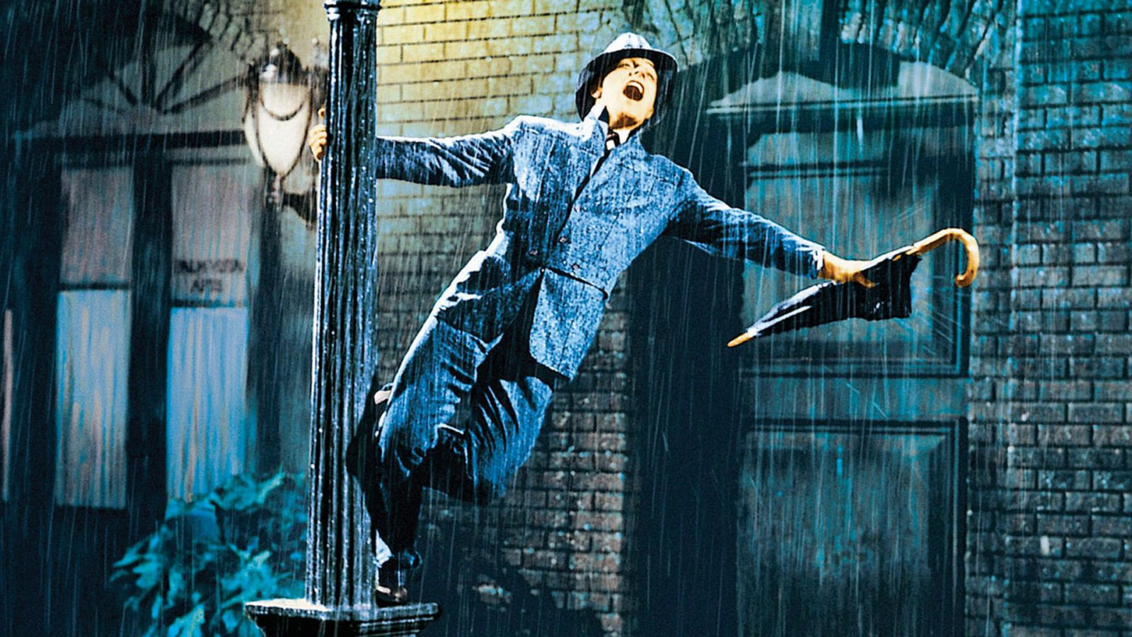 Gene Kelly does his famous dance in 'Singin' in the Rain,' which will be screened at the Riviera Theatre.