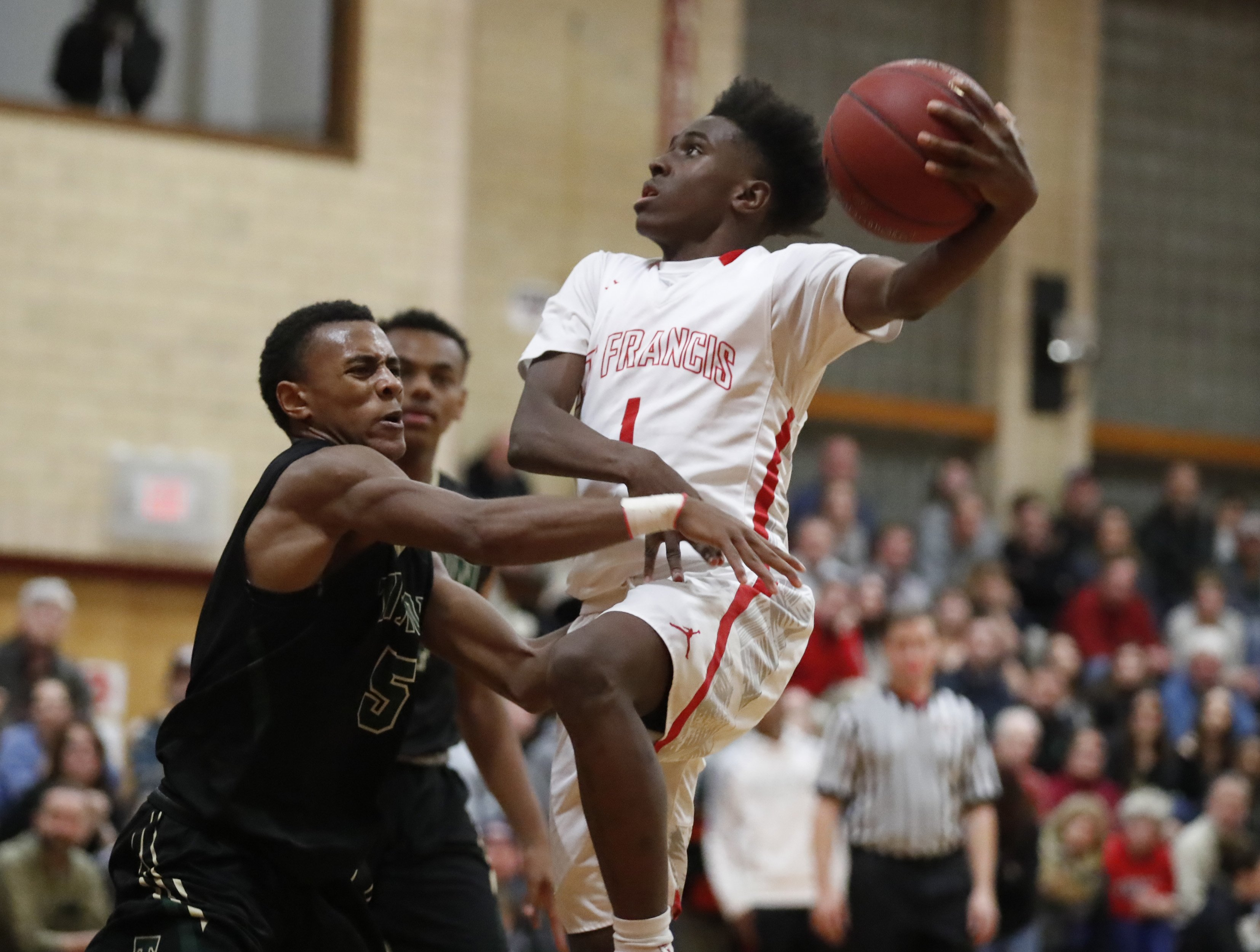 Julian Cunningham of St. Francis is part of the top-ranked large school team in boys basketball this week.