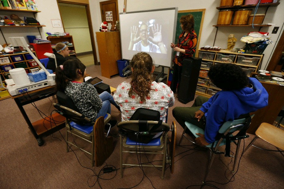 St. Mary's School for the Deaf students use Subpacs attached to their chairs to experience the sounds as teacher Joyce Trautman plays a music video. Students are, from left, Jonathan Allen, Alesyshka Rivera, Julia Bronneberg, and Isa Habeeb. (Mark Mulville/Buffalo News)