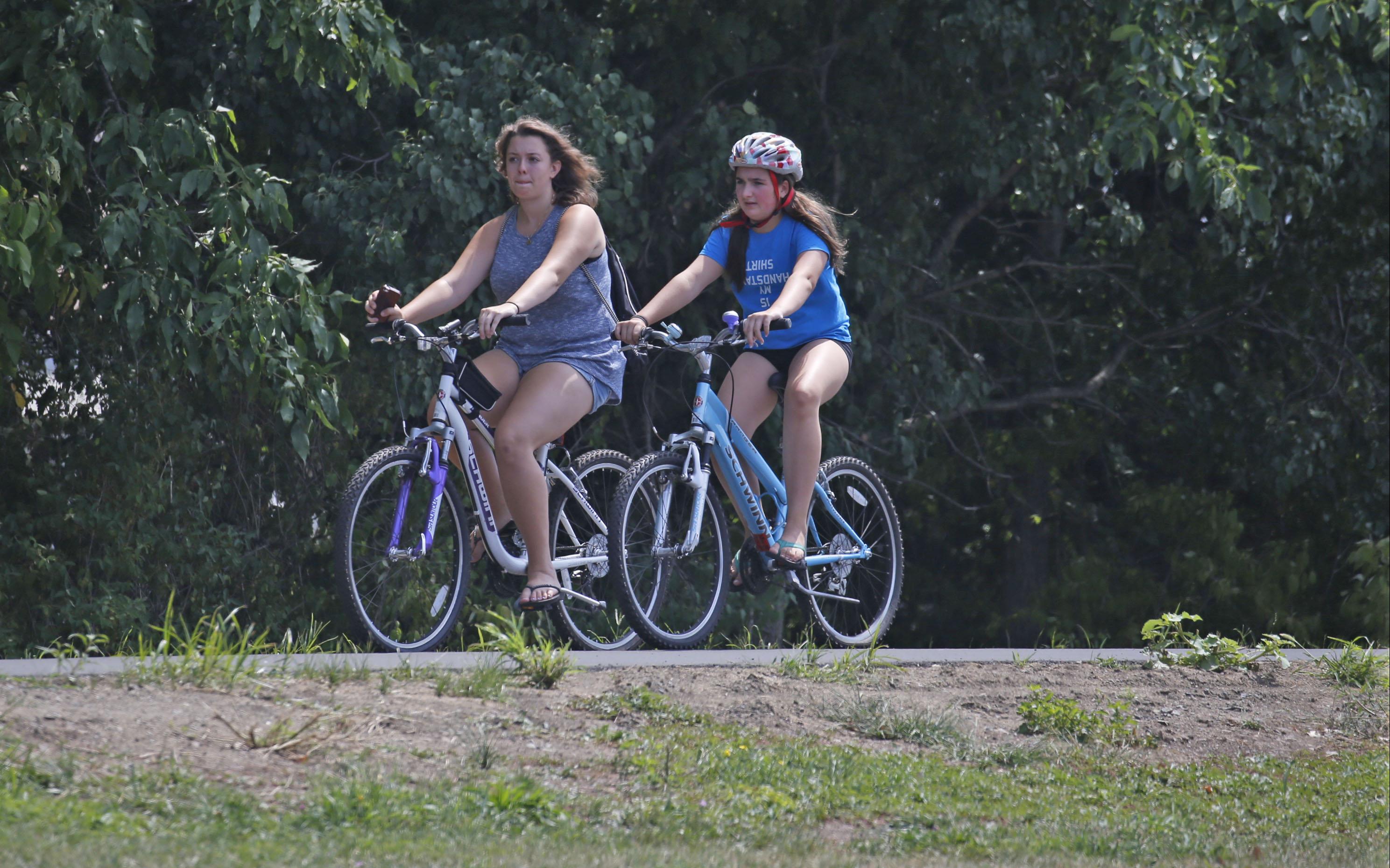 Some young bicyclists on the Tonawanda Rails to Trails section on Thursday, Aug. 11, 2016. (Robert Kirkham/Buffalo News)