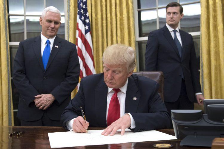Trump takes symbolic step on health care law