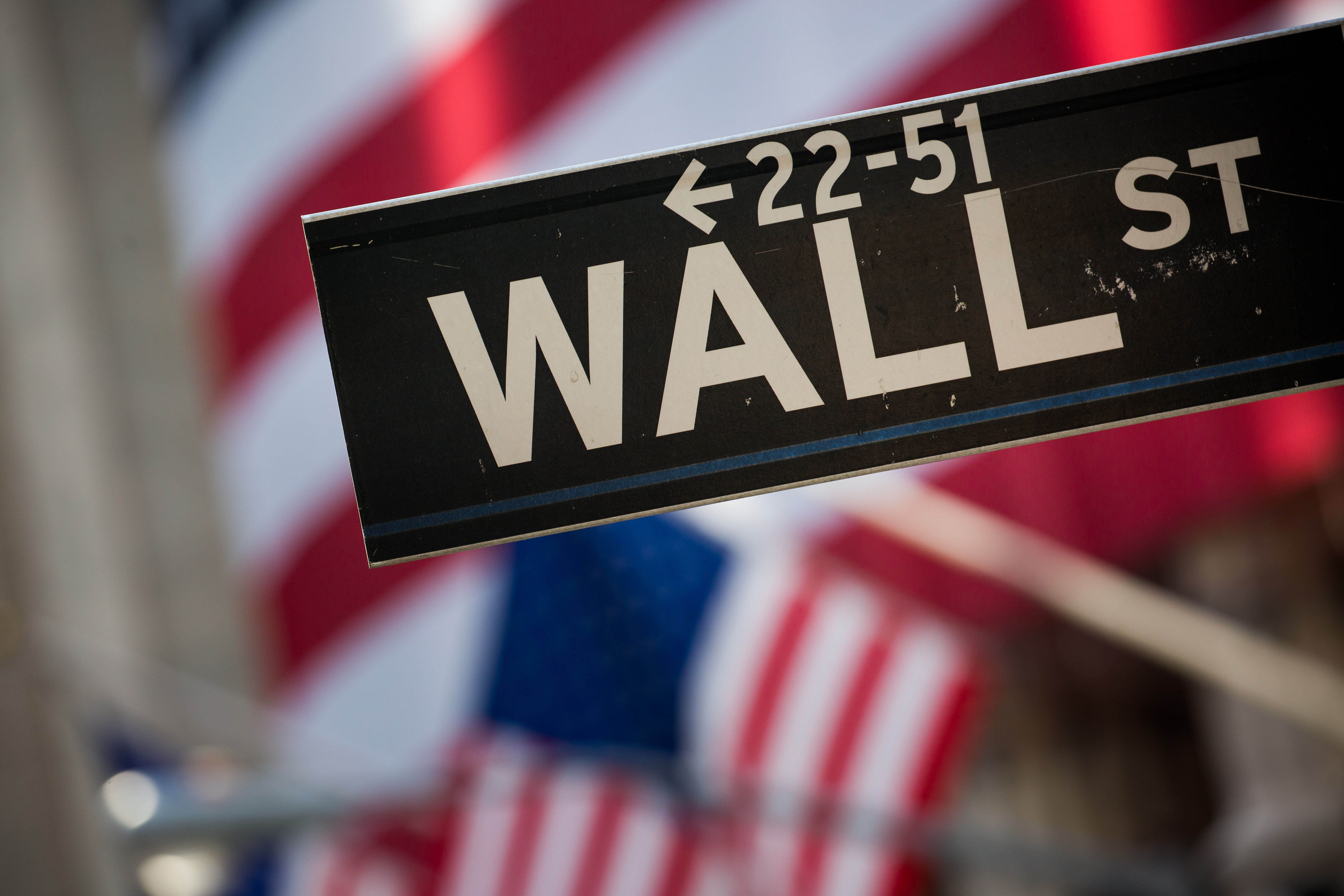 A Wall Street sign is displayed in front of the New York Stock Exchange in New York. (Bloomberg News)