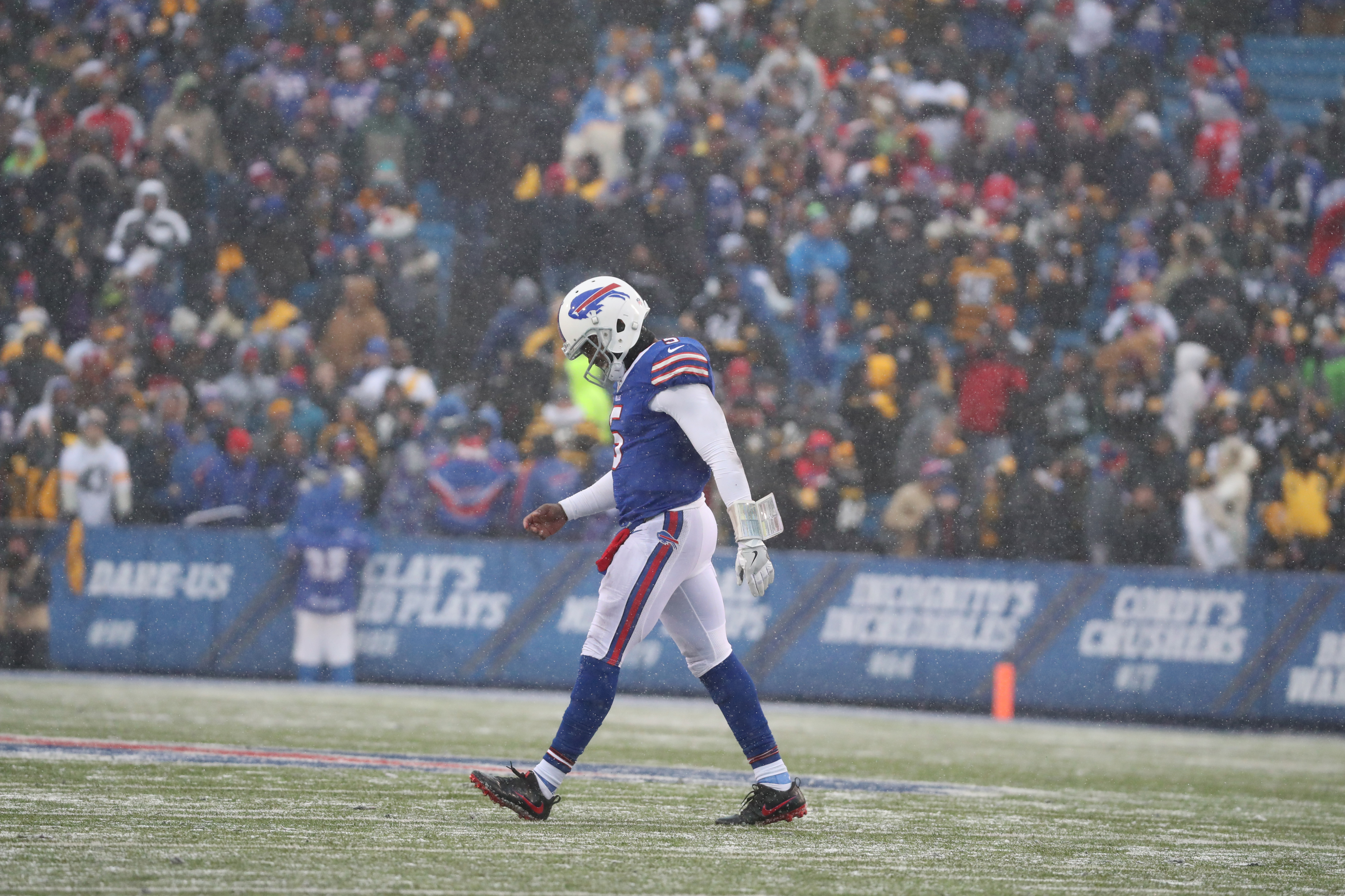 Buffalo Bills quarterback Tyrod Taylor (5) walks off the field after a three-and-out in the fourth quarter against the Steelers on Dec. 11, 2016.  (James P. McCoy/Buffalo News)