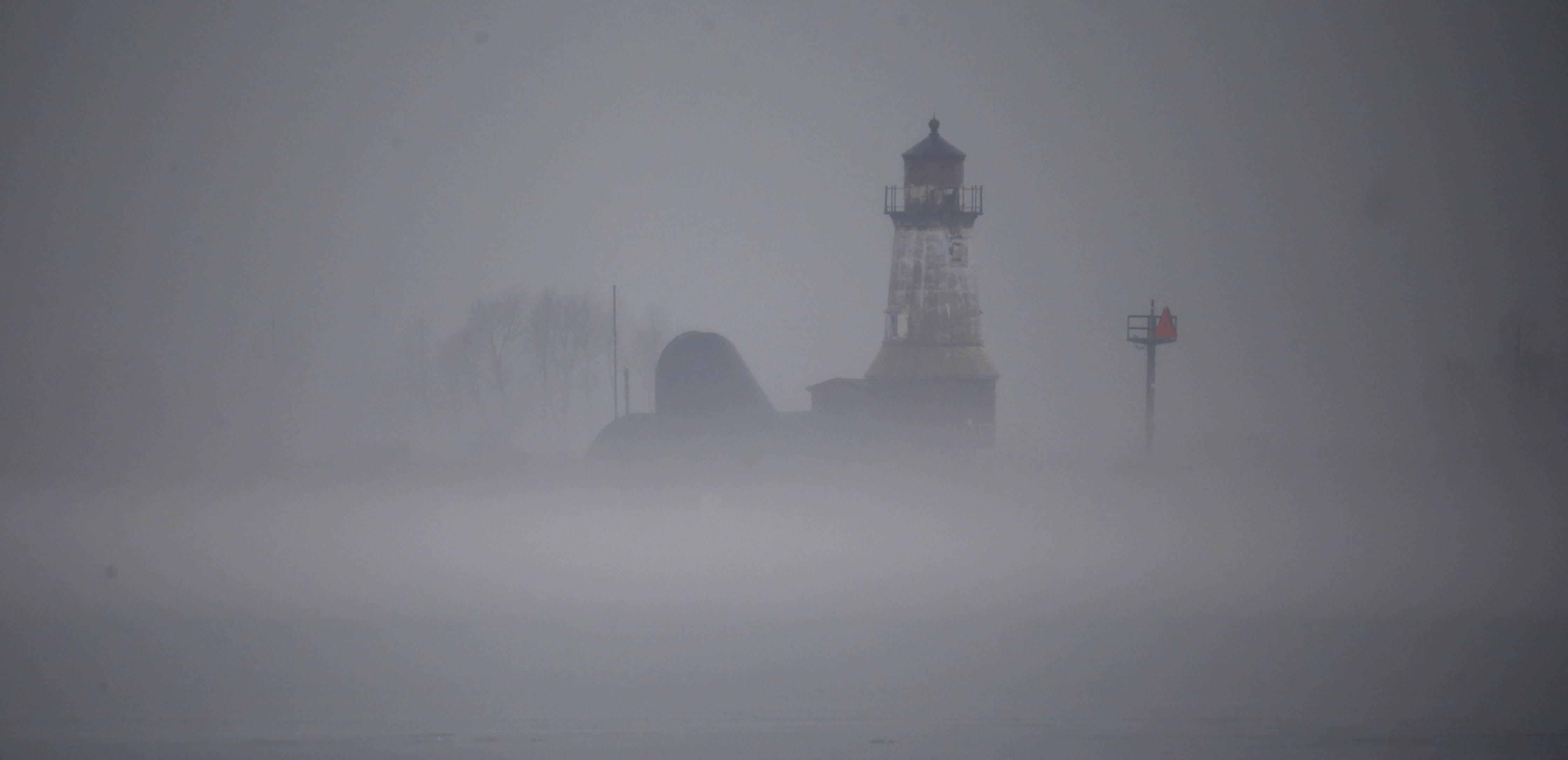 Rain and fog roll in along the Buffalo River on Tuesday, Jan. 17, 2017. (Harry Scull Jr./Buffalo News)