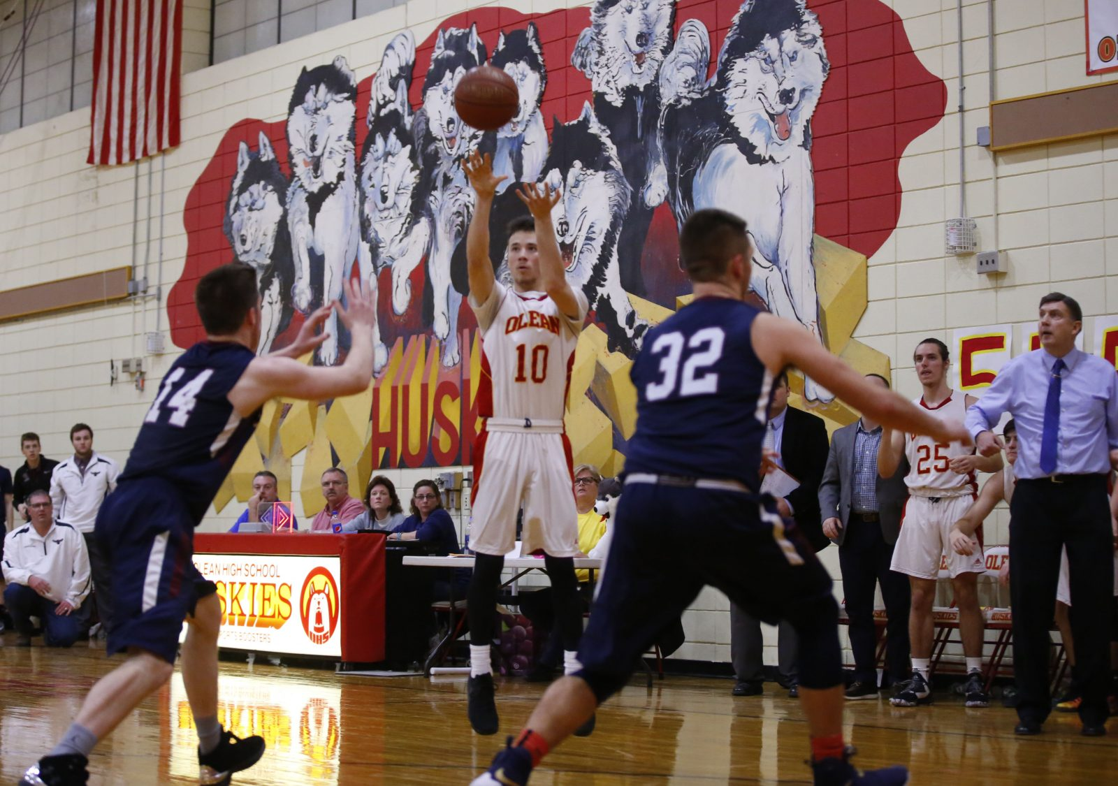 Olean's Monty Shoemaker hits the game-winning three-pointer against Chautauqua Lake. The triumph is part of the Huskies' current 15-game winning streak. (Harry Scull Jr./Buffalo News)