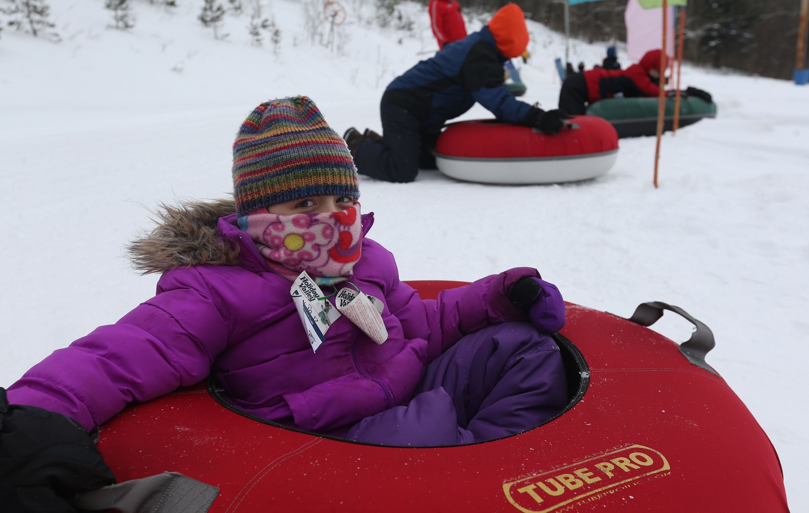 Addison Buchanan, 7, is nervous as it is her first time going down the big hill at Holiday Valley Tubing. One must be 42 inches tall to ride the big hill.  (Sharon Cantillon/Buffalo News)