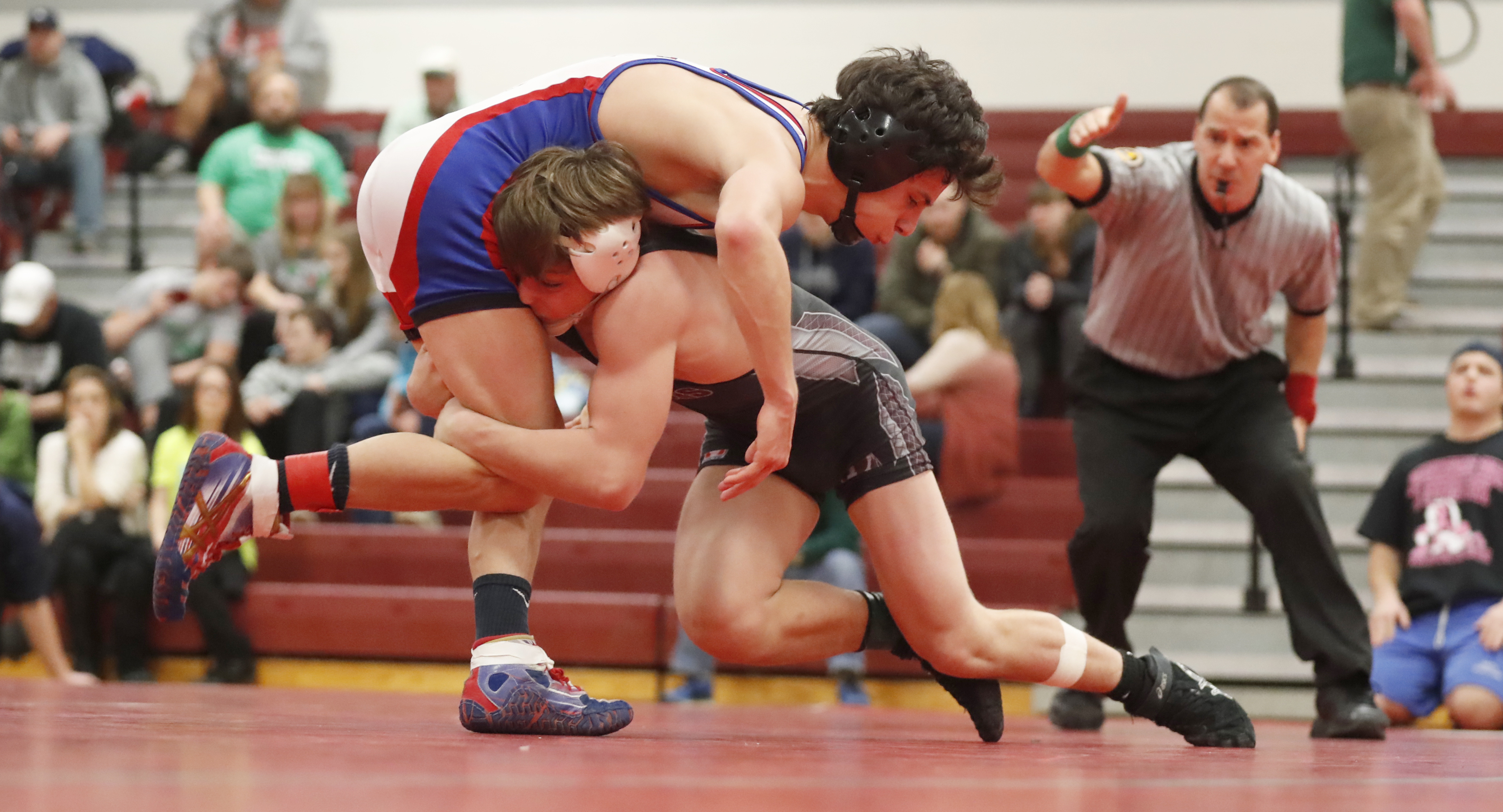 Zach Braddell of Tonawanda defeats Matt Genau of Williamsville South for the 120-pound title during the ECIC Championships at Starpoint on Jan. 21. (Harry Scull Jr./Buffalo News)