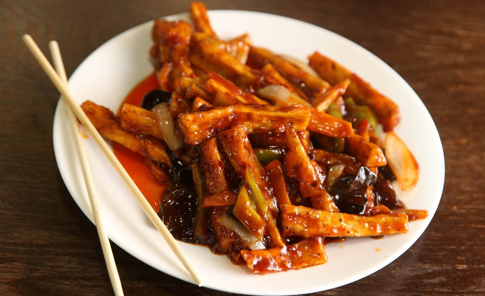 The eggplant with garlic sauce is made with onion, carrots, black mushrooms and green peppers at 1280 China Taste. (Sharon Cantillon/Buffalo News)