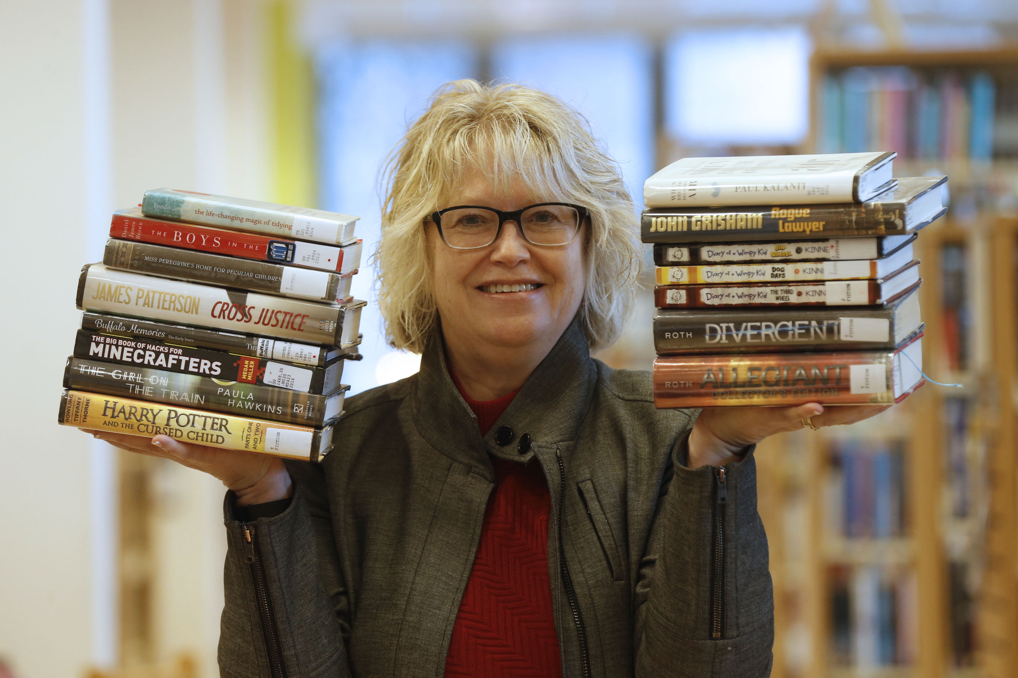 Buffalo and Erie County Libraries Director Mary Jean Jakubowski showcases some of the most popular reads in Erie County.  (Robert Kirkham/Buffalo News)
