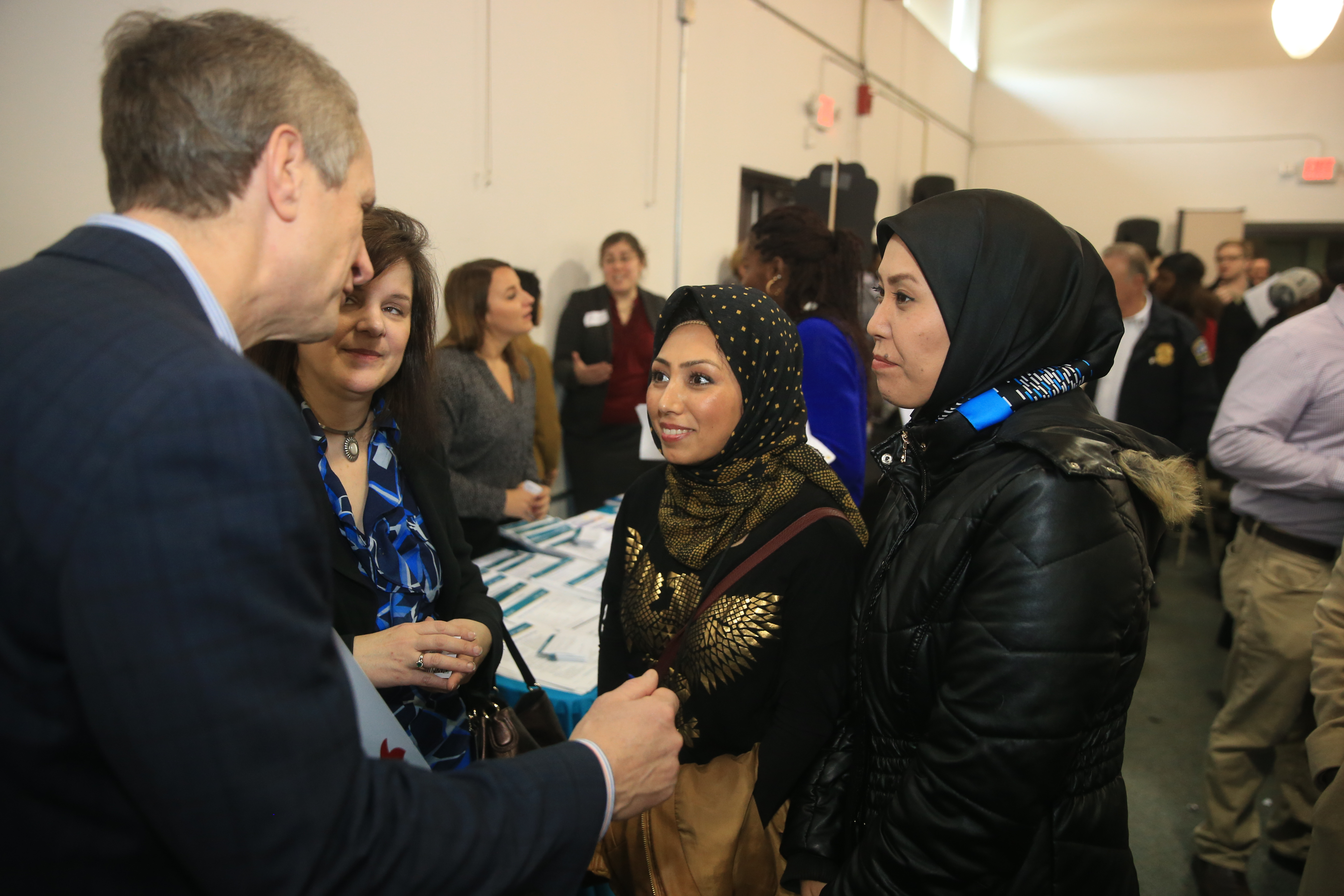 New York State Assemblyman Sean Ryan, left, talks with Lisa Strand of Legal Aide, Yelda Natiq a translator, and Robobeh Ohorbanzedah a Afghan refugee as representatives from several legal service providers, resettlement agencies, government agencies and nonprofit organizations will be present to assist with issues, provide limited representation and address concerns participants of the ÔKnow Your RightsÕ Open House for local immigrants and refugees, at  Buffalo, N.Y. on  Saturday,  Feb. 4, 2017.  (John Hickey/Buffalo News)