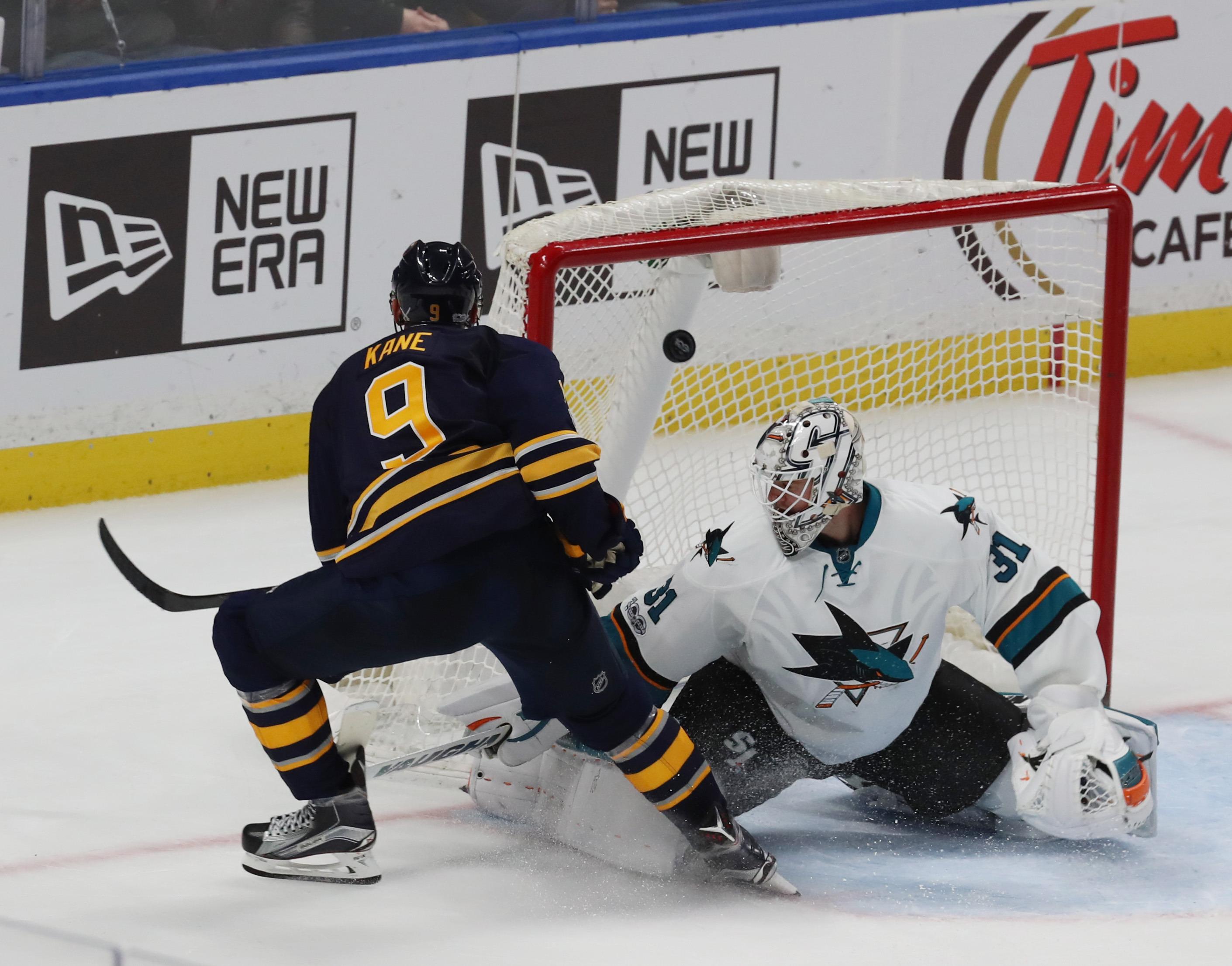Evander Kane beats San Jose goalie Martin Jones for the winning goal in overtime (James P. McCoy/Buffalo News)