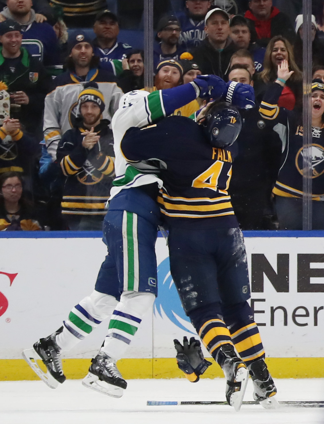 Buffalo Sabres defenseman Justin Falk (41) levels Vancouver Canucks right wing Alexandre Burrows (14) after he hit Buffalo Sabres goalie Robin Lehner (40) in the first period at KeyBank Center in Buffalo N.Y. on Sunday, Feb. 12, 2017.  (James P. McCoy/Buffalo News)