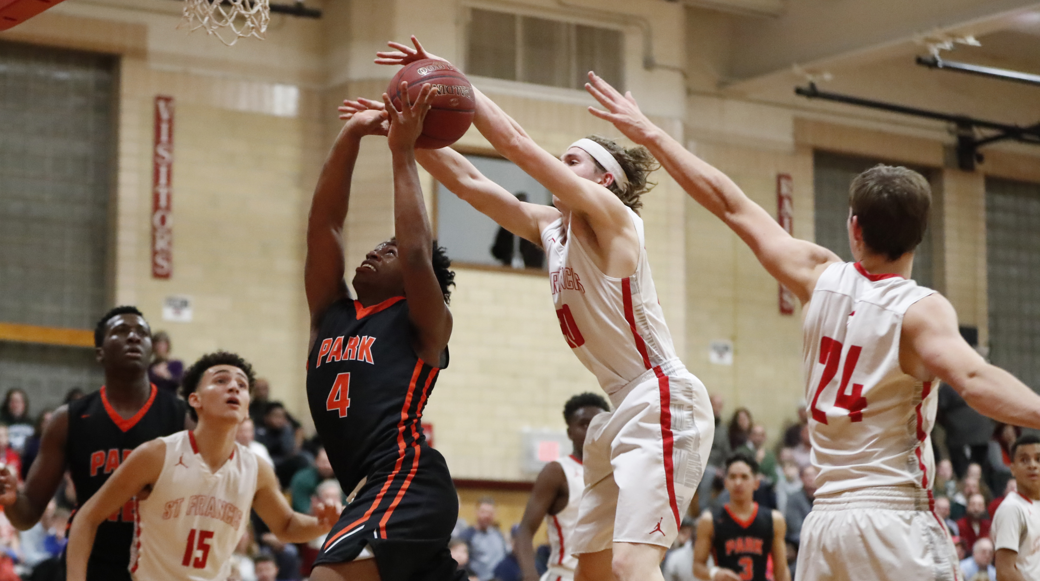 Park's Daniel Scott has the ball stripped by St. Francis Bo Sireika during first half action at St. Francis on Friday. (Harry Scull Jr./Buffalo News)