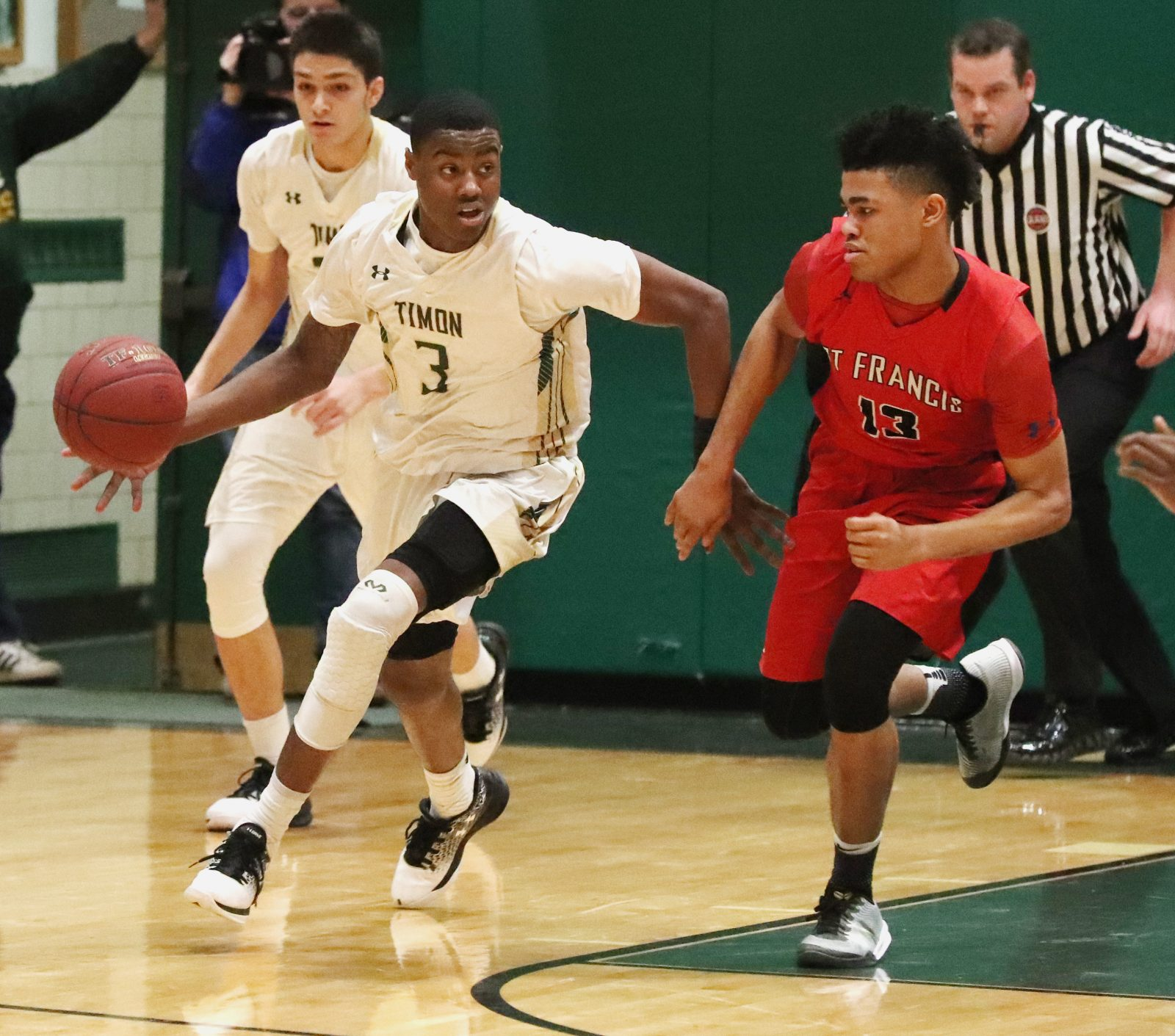 Davion Warren, left, and the Bishop Timon-St. Jude Tigers shared the League A title with Roburt Welch and the St. Francis Red Raiders. A tiebreaker determined that Timon will be the top seed in the Manhattan Cup playoffs.  (James P. McCoy/Buffalo News)