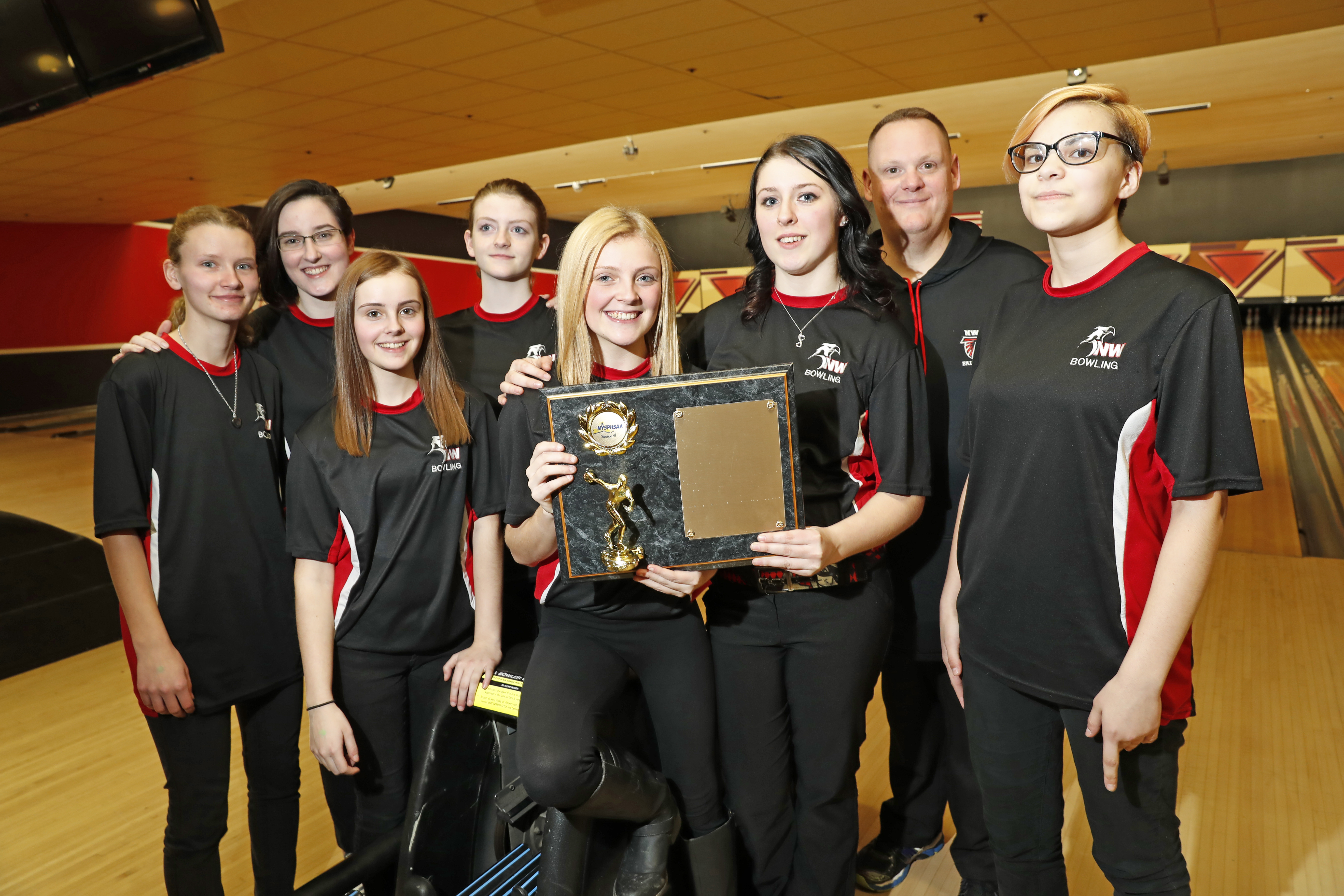 The Niagara-Wheatfield girls bowling team shows off some hard-earned hardware at the Section VI bowling championships on Wednesday in Cheektowaga. (Harry Scull Jr. / Buffalo News)