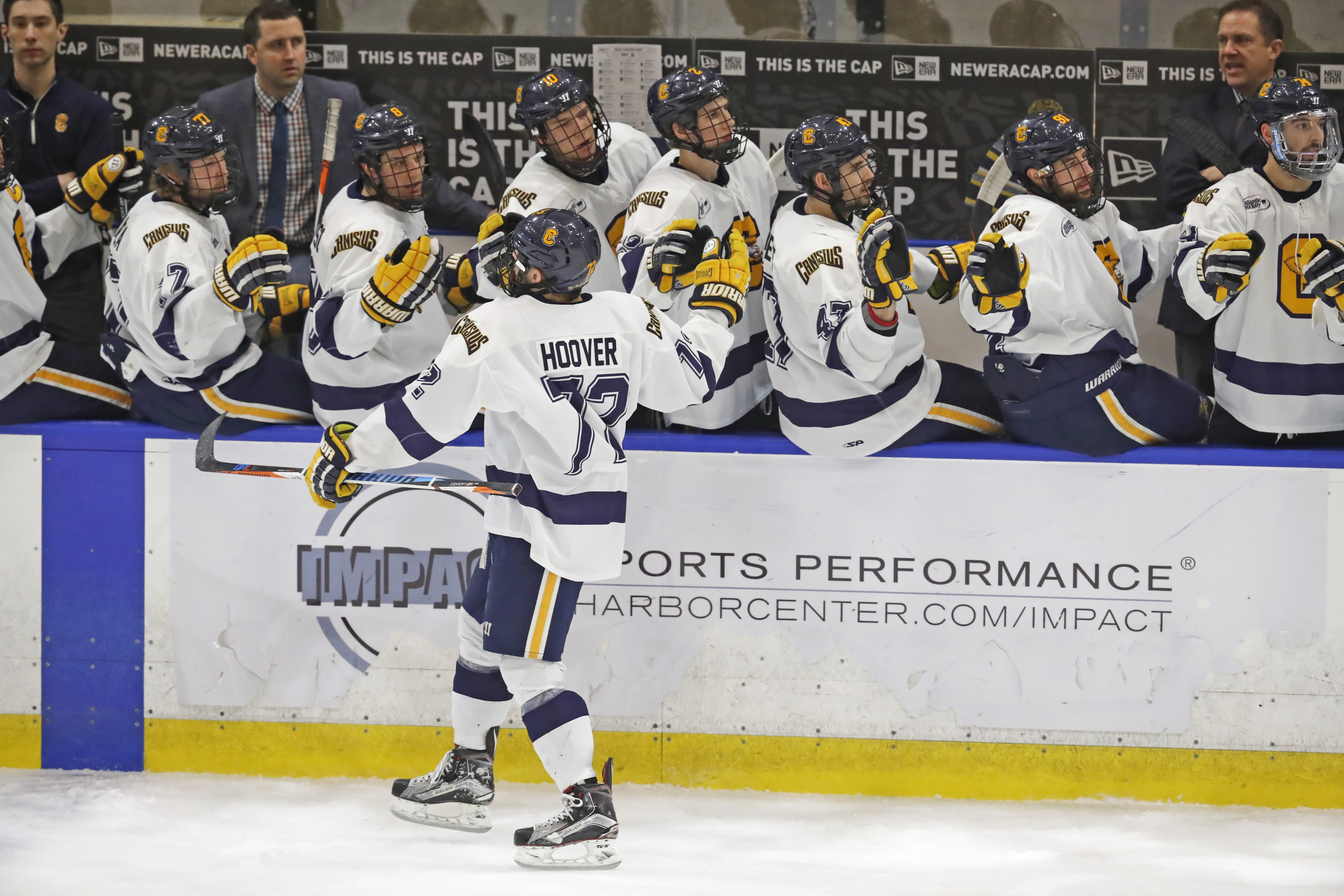 Canisius' Matt Hoover celebrates his first-period goal with the bench against Niagara. (Harry Scull Jr./Buffalo News)