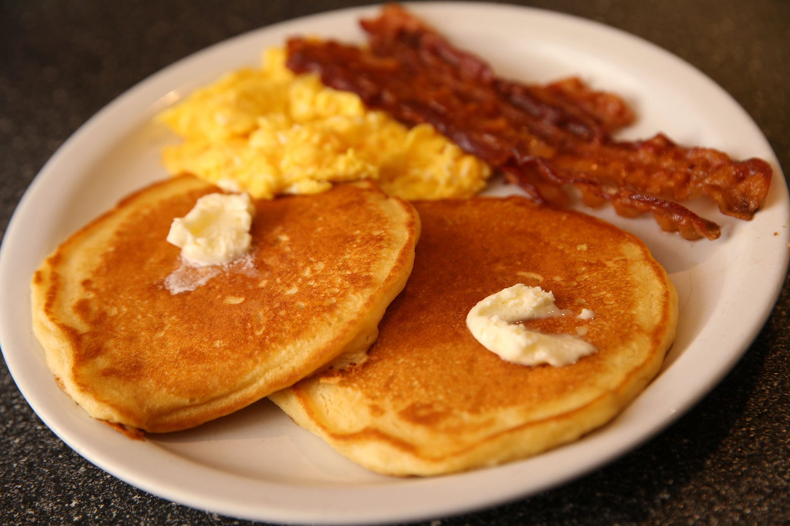 Breakfast, including this triple special, is available all day at Taki's Restaurant. (Sharon Cantillon/Buffalo News)