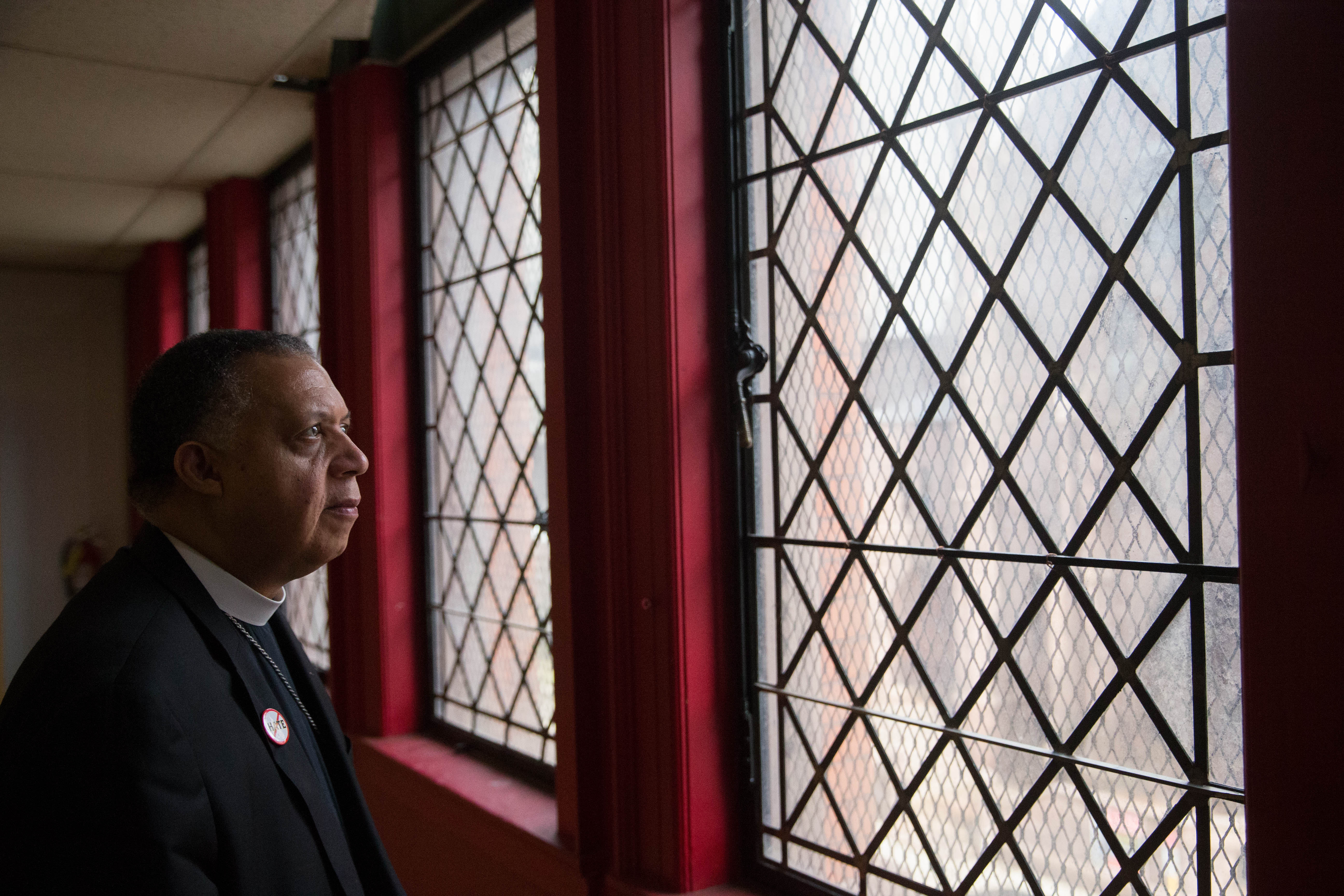 The Very Rev. Will H. Mebane, Jr., interim dean at St. Paul's Cathedral, looks over a space in the former church office and educational building at 128 Pearl St. which the church is planning to develop into luxury apartments.  (Derek Gee/Buffalo News)
