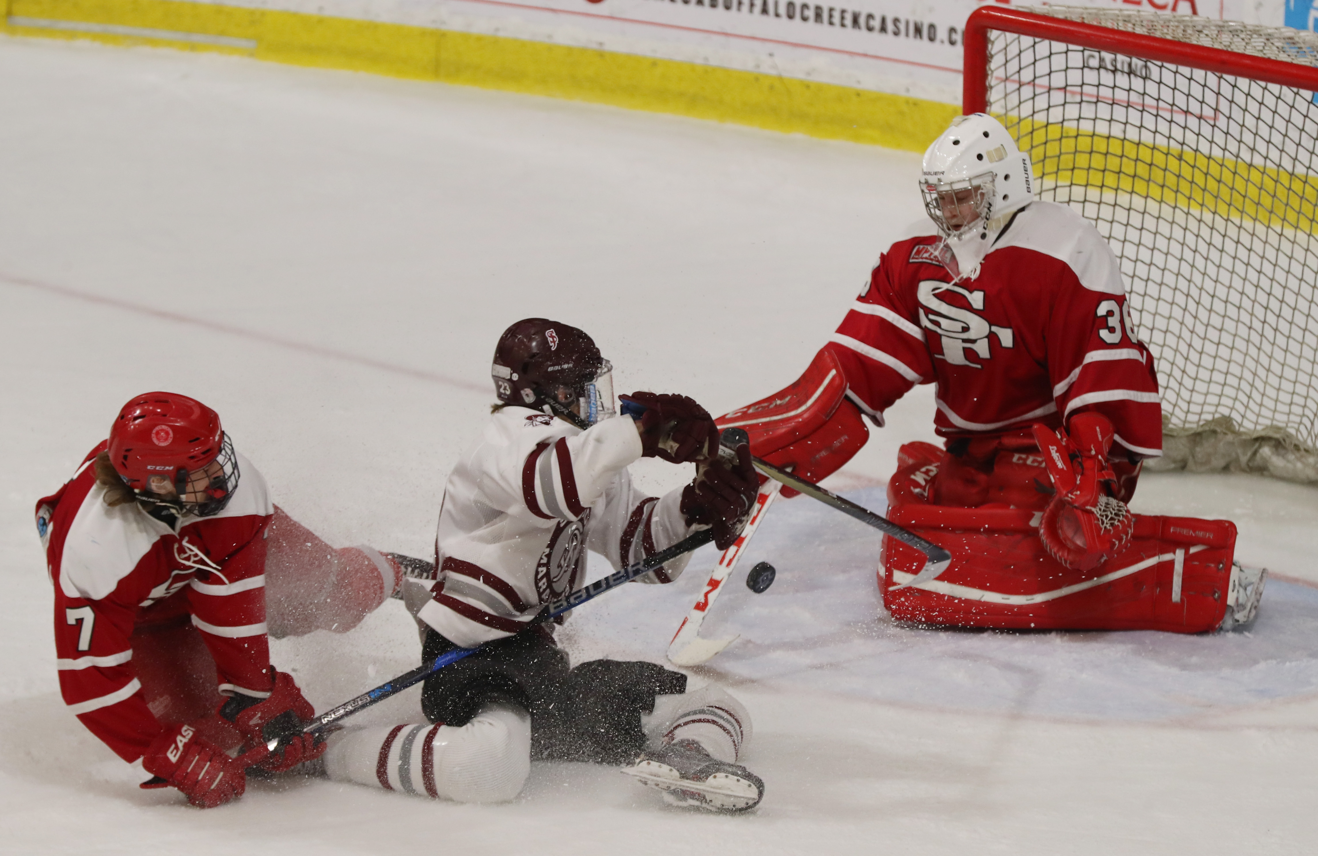 Nathan Berke of St. Joe's was awarded a penalty shot after he was pulled down from behind by St. Francis' Nathan Howayek in front of goalie Vincent Vaccaro in their Niagara Cup semifinal. St. Joe's won, 9-0, and will face Canisius for the championship.