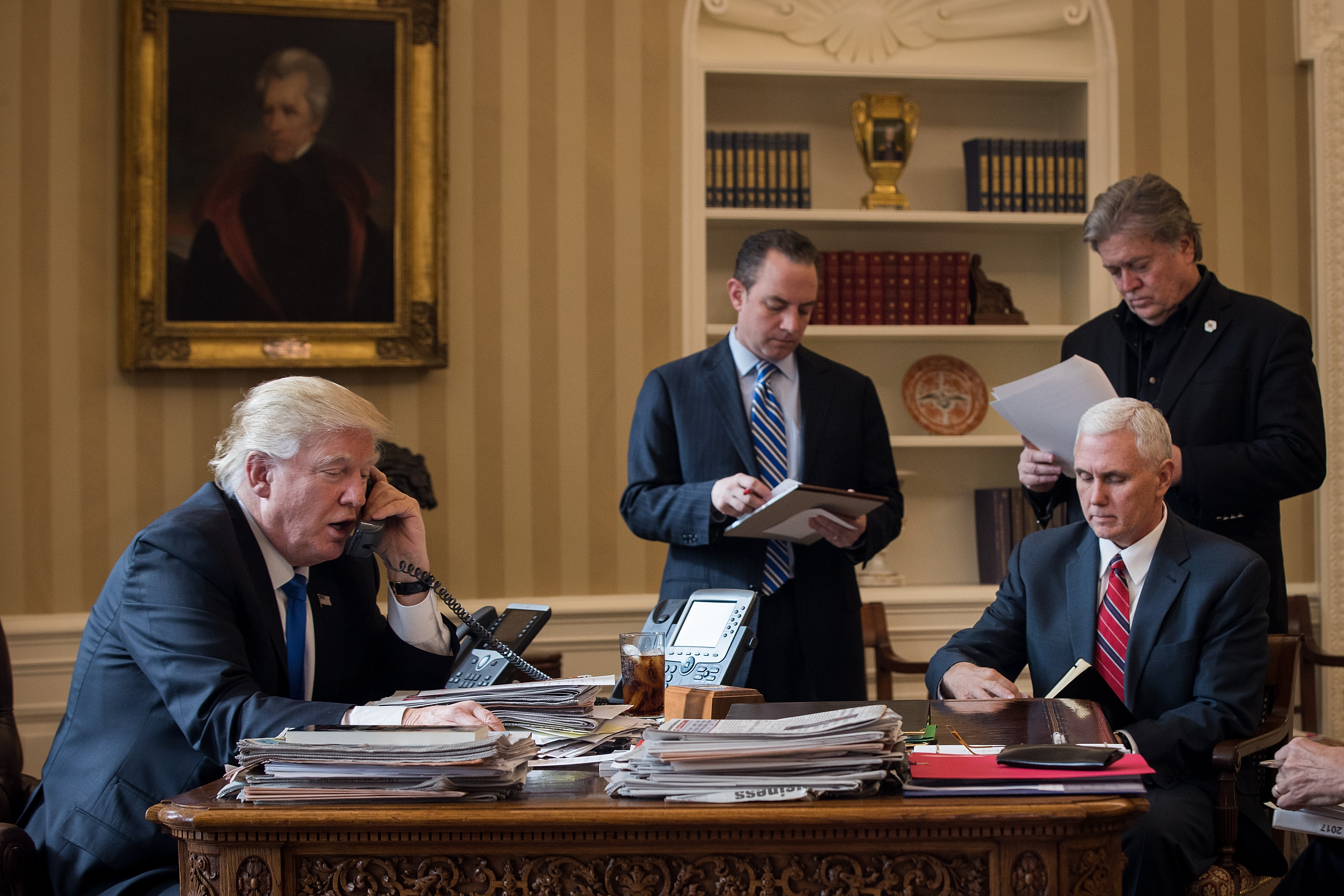 President Donald Trump speaks on the phone with Russian President Vladimir Putin in the Oval Office of the White House, Jan. 28, 2017. (Getty Images)