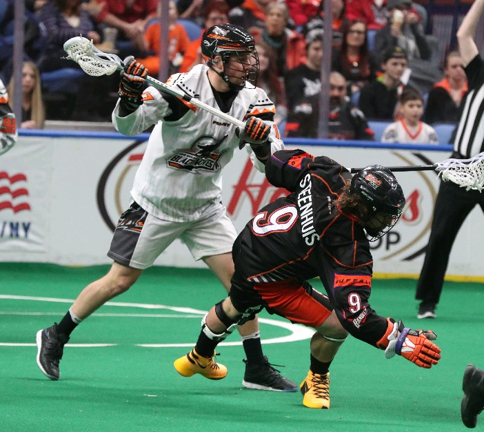 Bandits forward Mark Steenhuis battles New England's Zak Reid in Friday's game. (James P. McCoy / Buffalo News)
