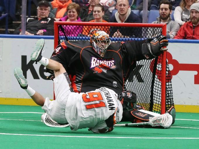 Bandits goalie Dave DiRuscio tries to stop Kyle Buchanan of New England in Friday's game. (James P. McCoy / Buffalo News)