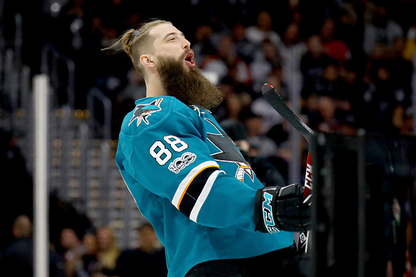 Free-spirited defenseman Brent Burns hits town Tuesday leading NHL blueliners in goals and points (Getty Images).
