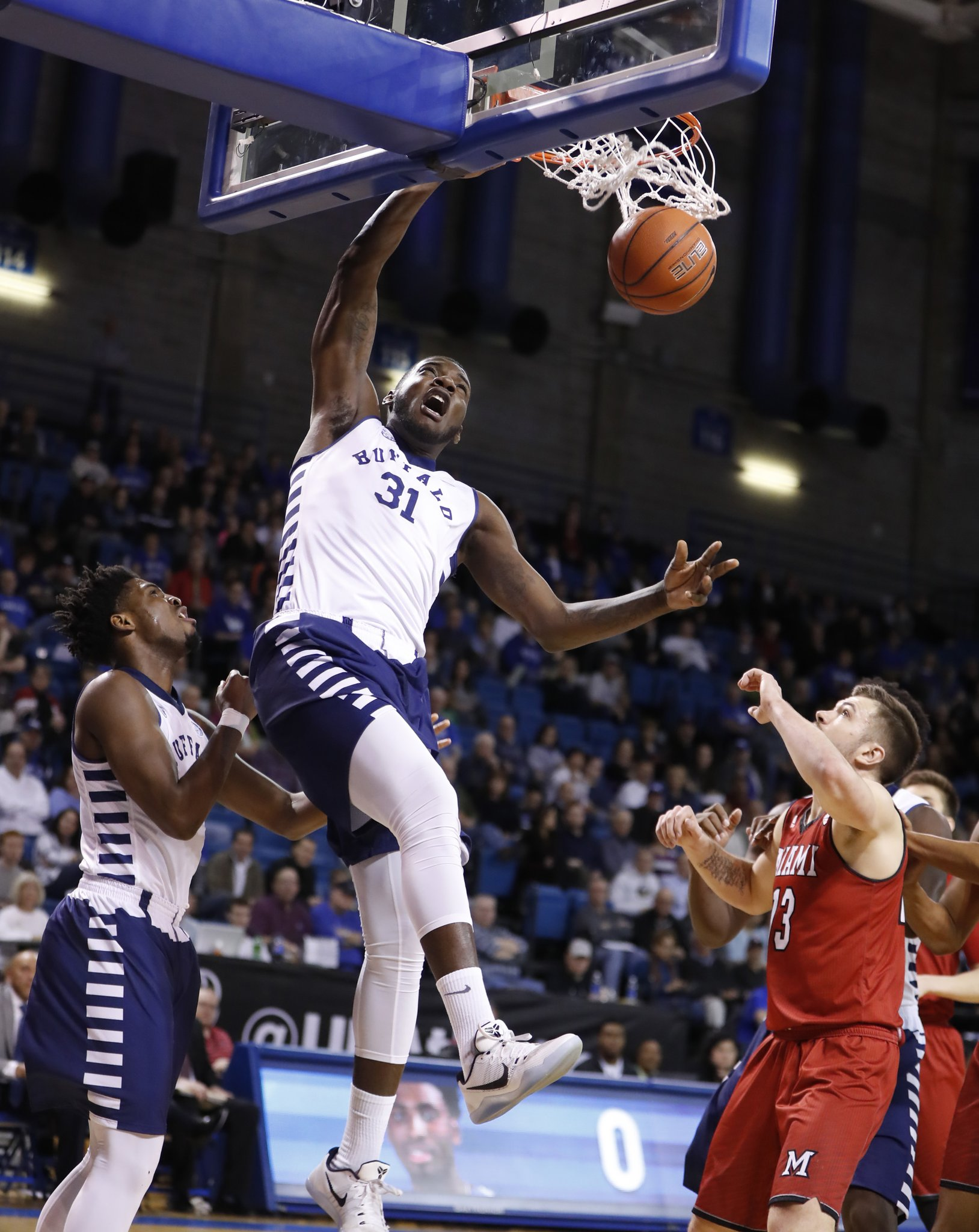 Raheem Johnson dunks vs. Miami Ohio. (Harry Scull Jr./Buffalo News)