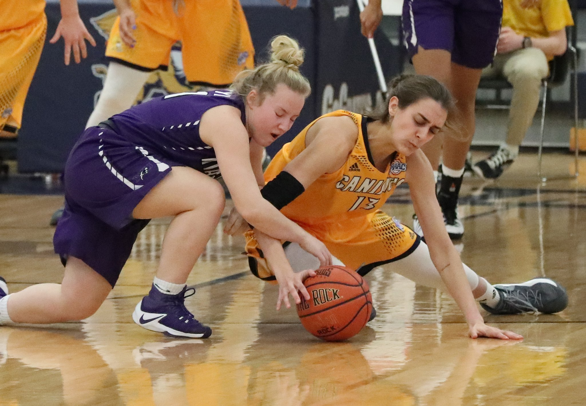 Canisius' Maria Welch and Niagara's Maggie McIntyre go for a loose ball. (James P. McCoy/Buffalo News)