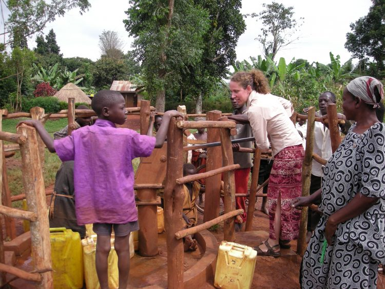 Kim Krytus at the village water pump in Kyabirwa, Uganda, 2007, where she was evaluating a family planning program.