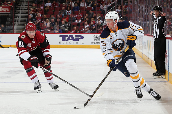 Jack Eichel controls the puck ahead of Arizona's Lawson Crouse (Getty Images).